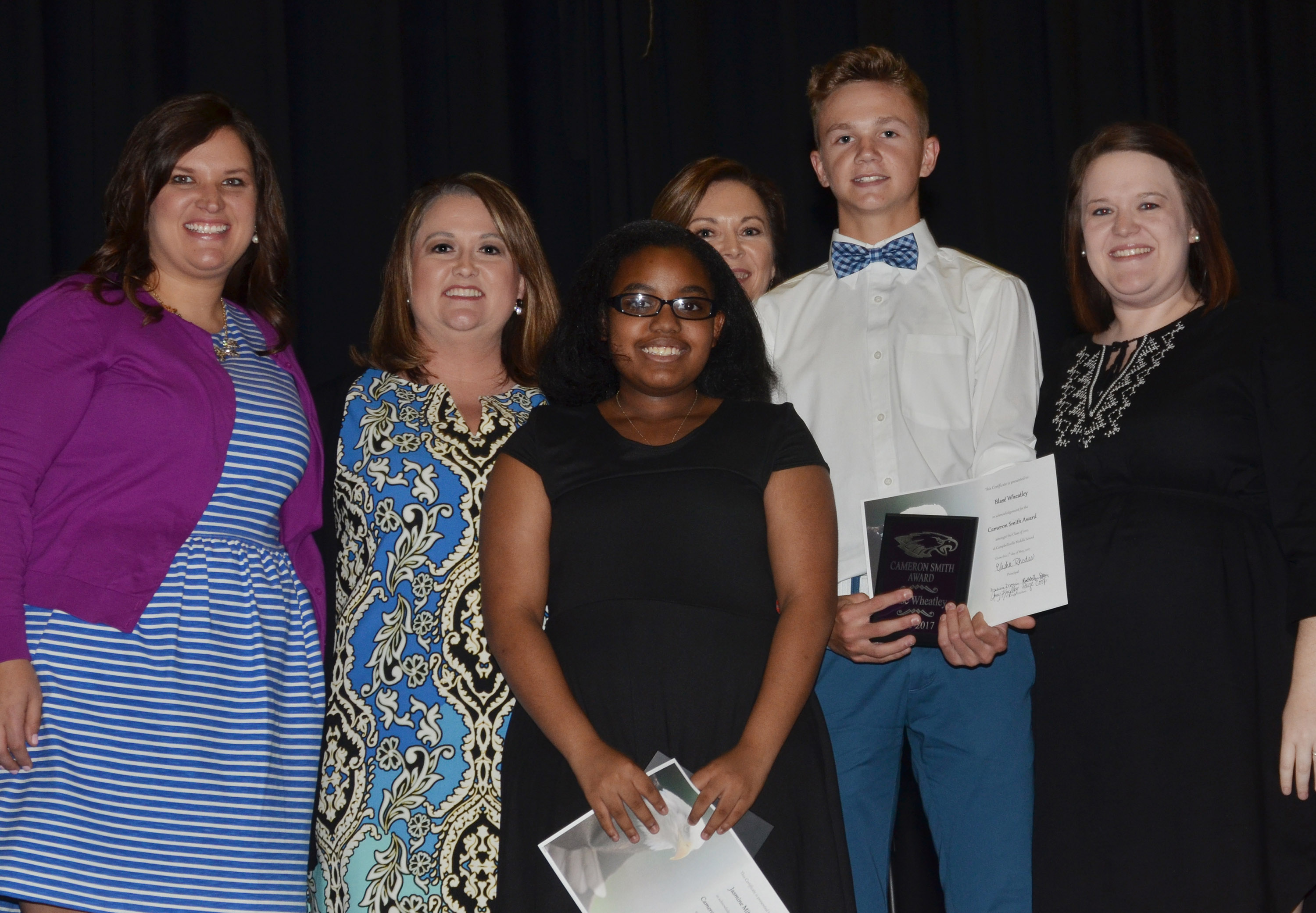 CMS eighth-graders Jasmine Mitchell and Blase Wheatley receive the Cameron Smith awards from teachers, from left, Robbilyn Speer, Amy Knifley, Melisa Morris and Paige Cook.