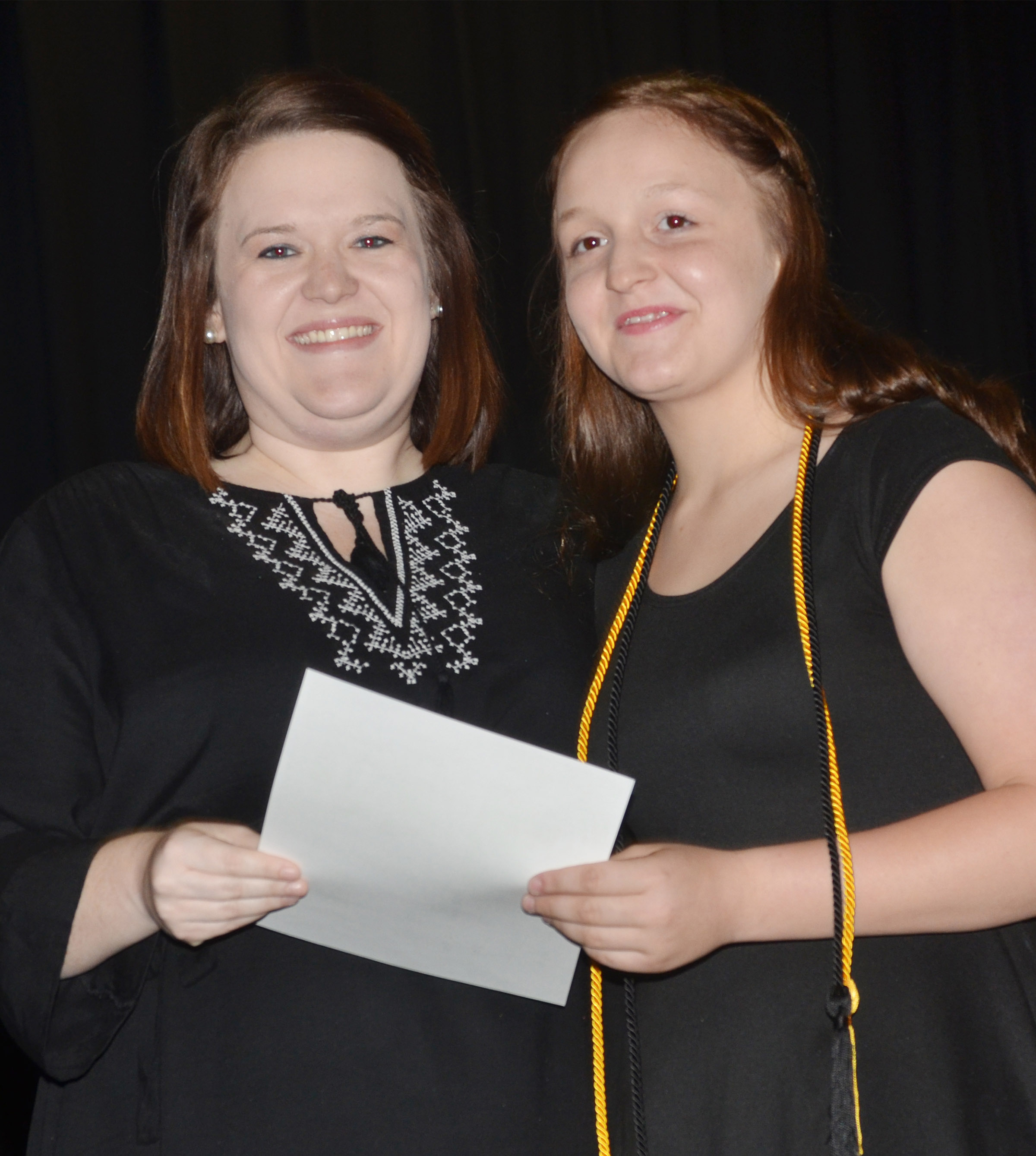 CMS eighth-grader Destiny Hicks receives the reading award from teacher Paige Cook.
