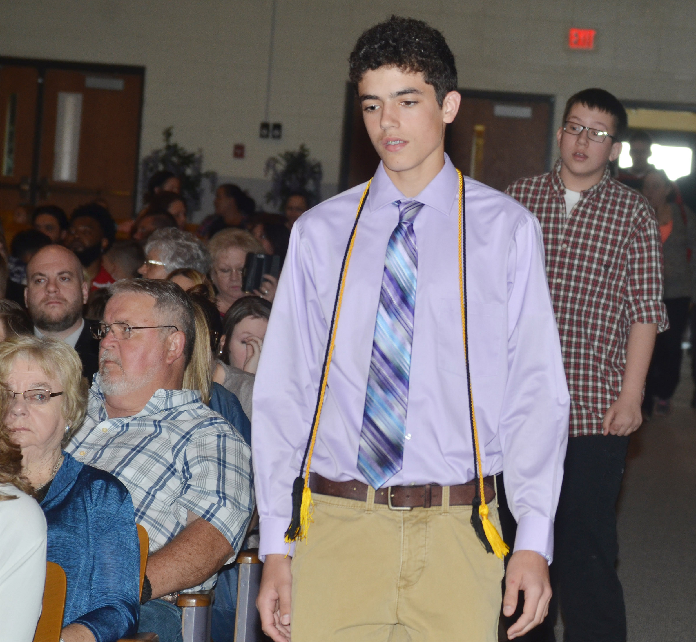 CMS eighth-grader Kameron Smith walks in for the recognition ceremony.