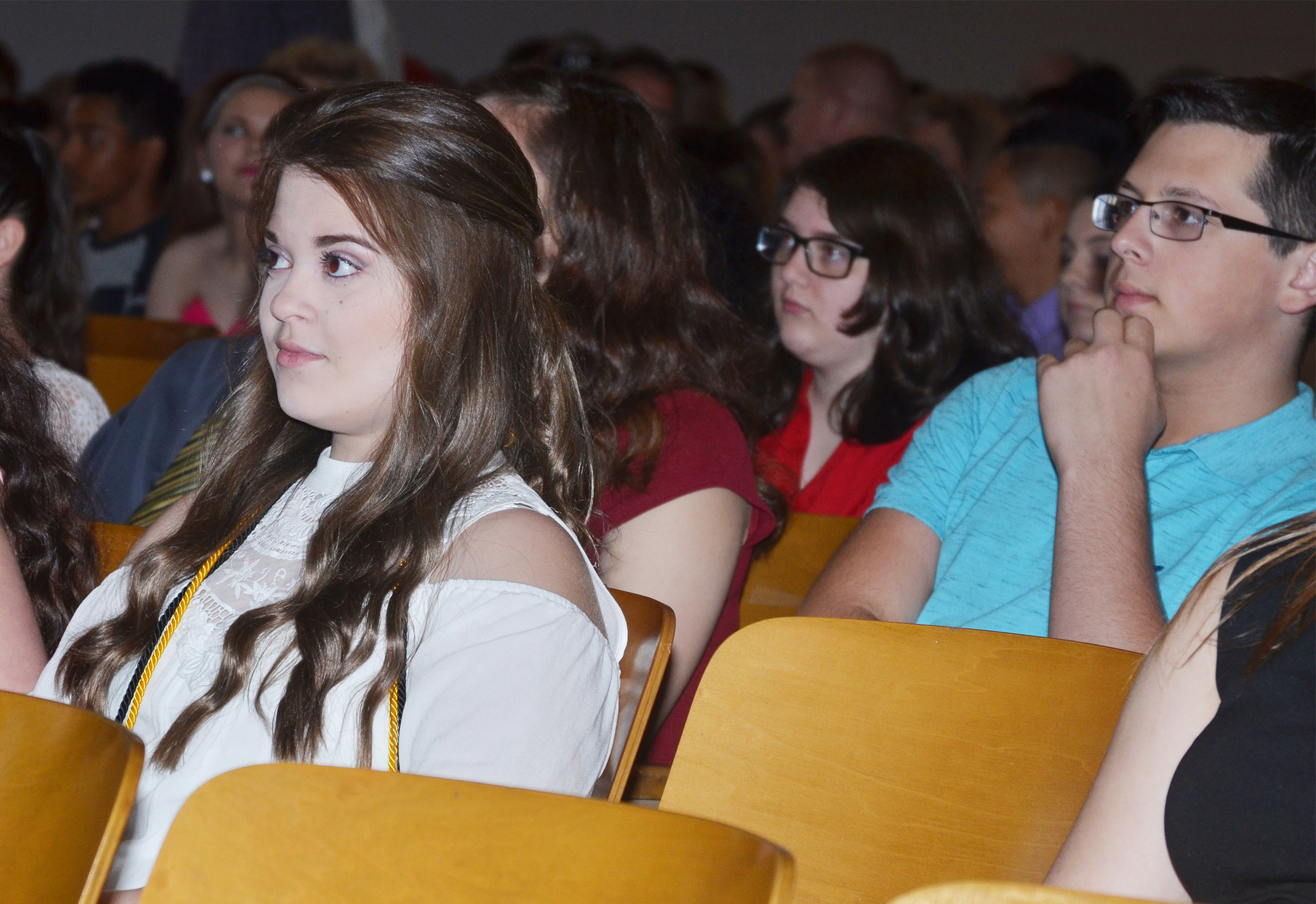 CMS eighth-graders Chloe Garrett and Devan Keith listen as they are recognized.