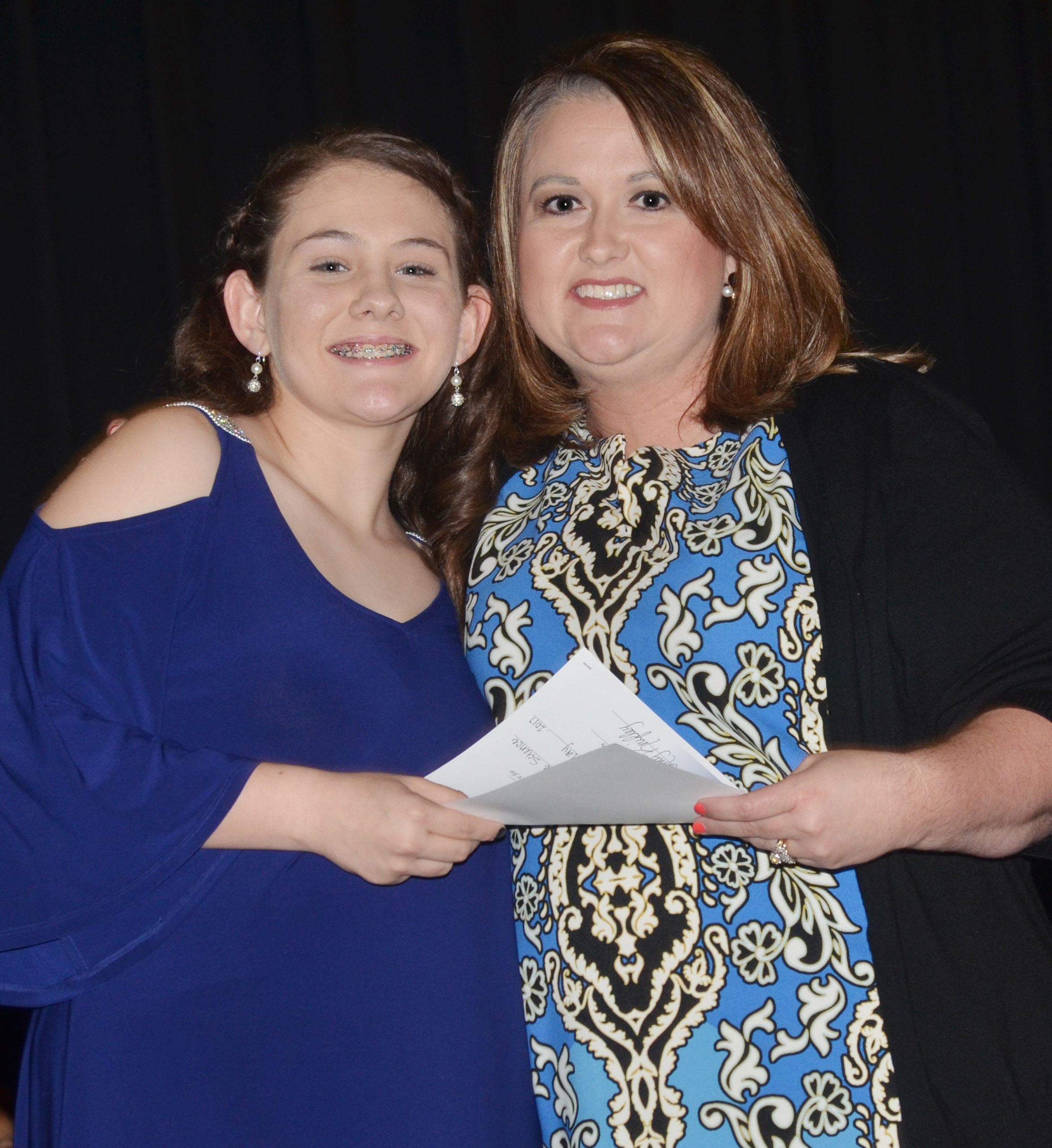 CMS eighth-grader Kaylee Reynolds receives the science award from teacher Amy Knifley.