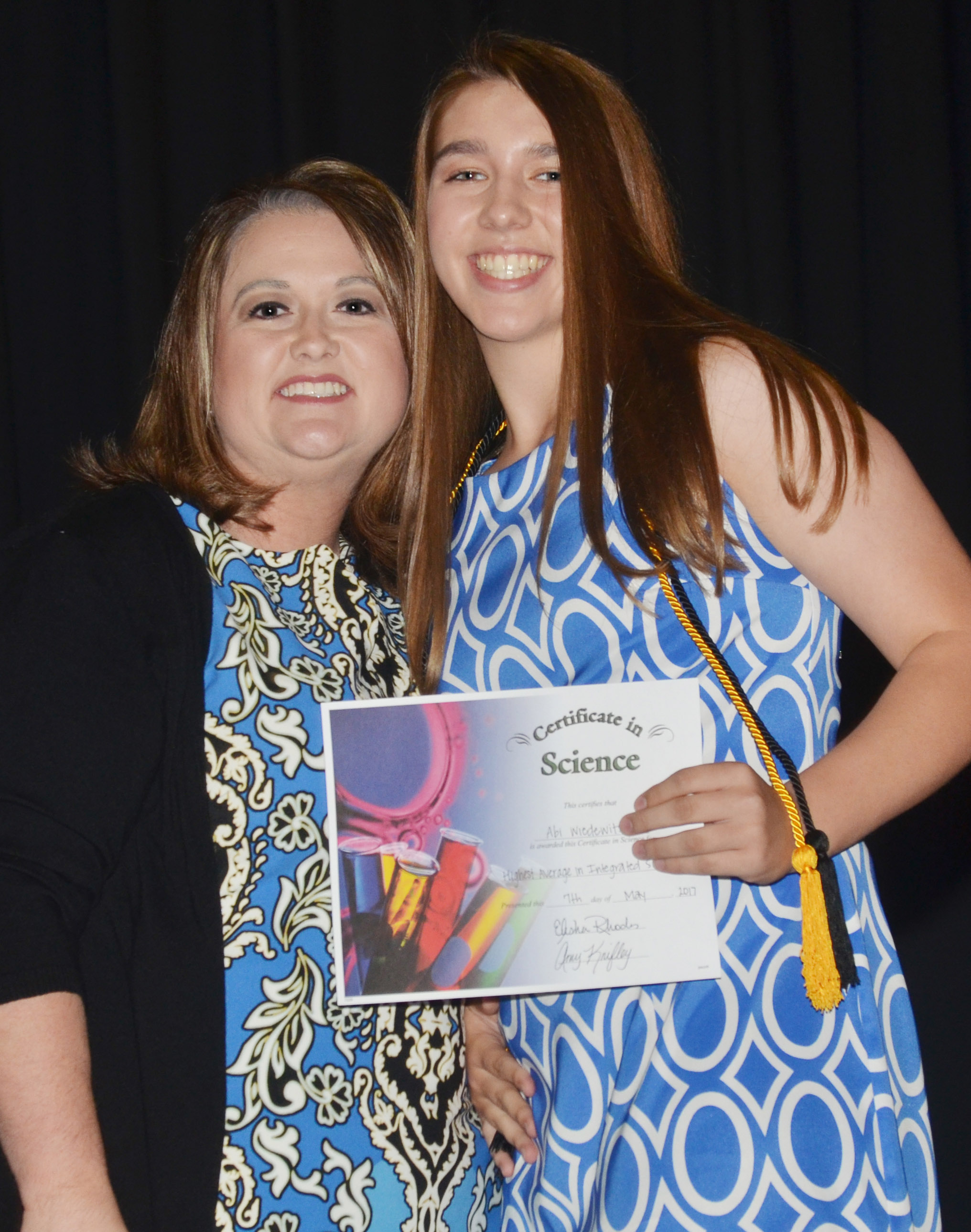 CMS eighth-grader Abi Wiedewitsch receives the integrated science award from teacher Amy Knifley.