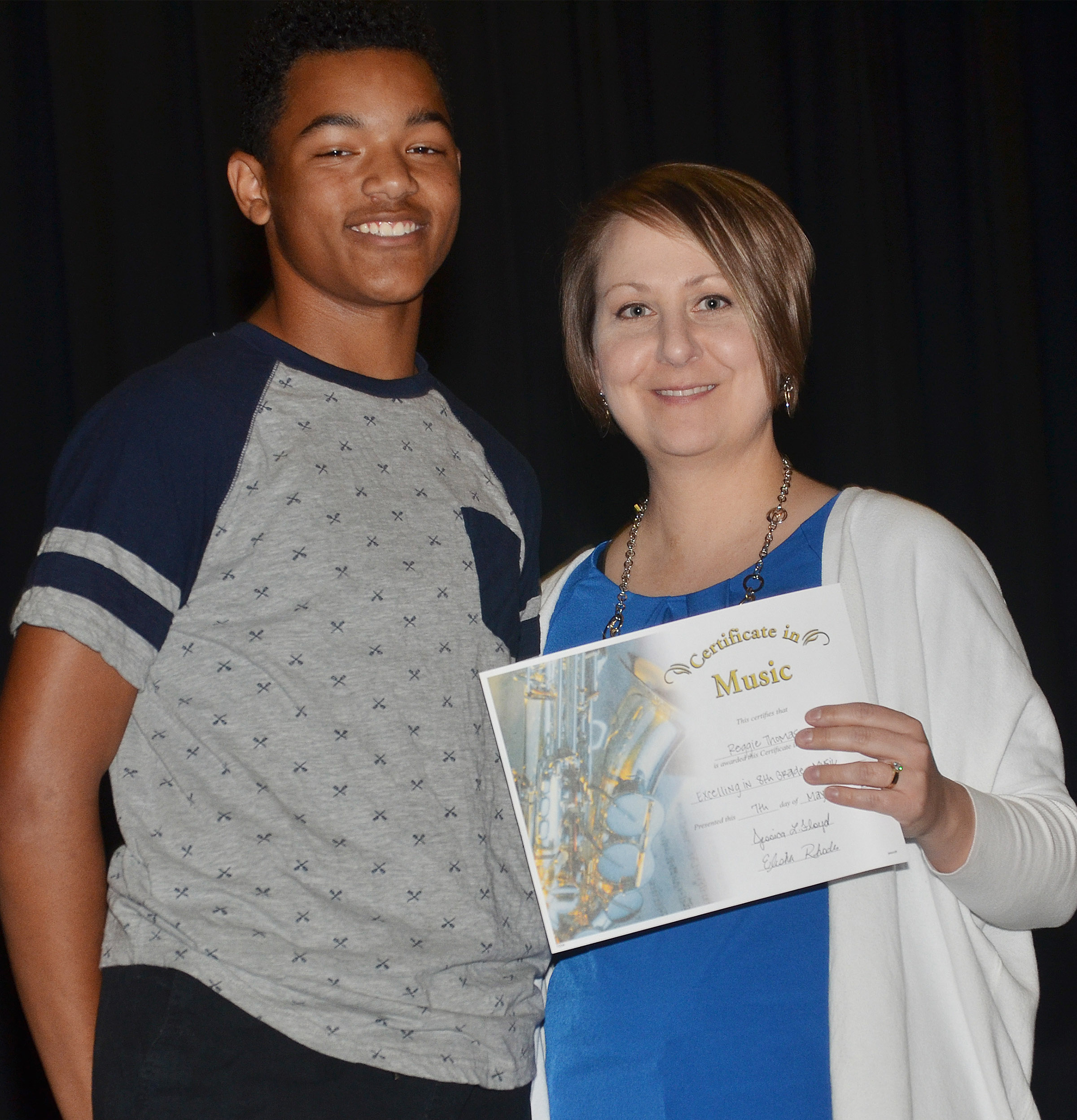 CMS eighth-grader Reggie Thomas receives the general music award from teacher Jessica Floyd.