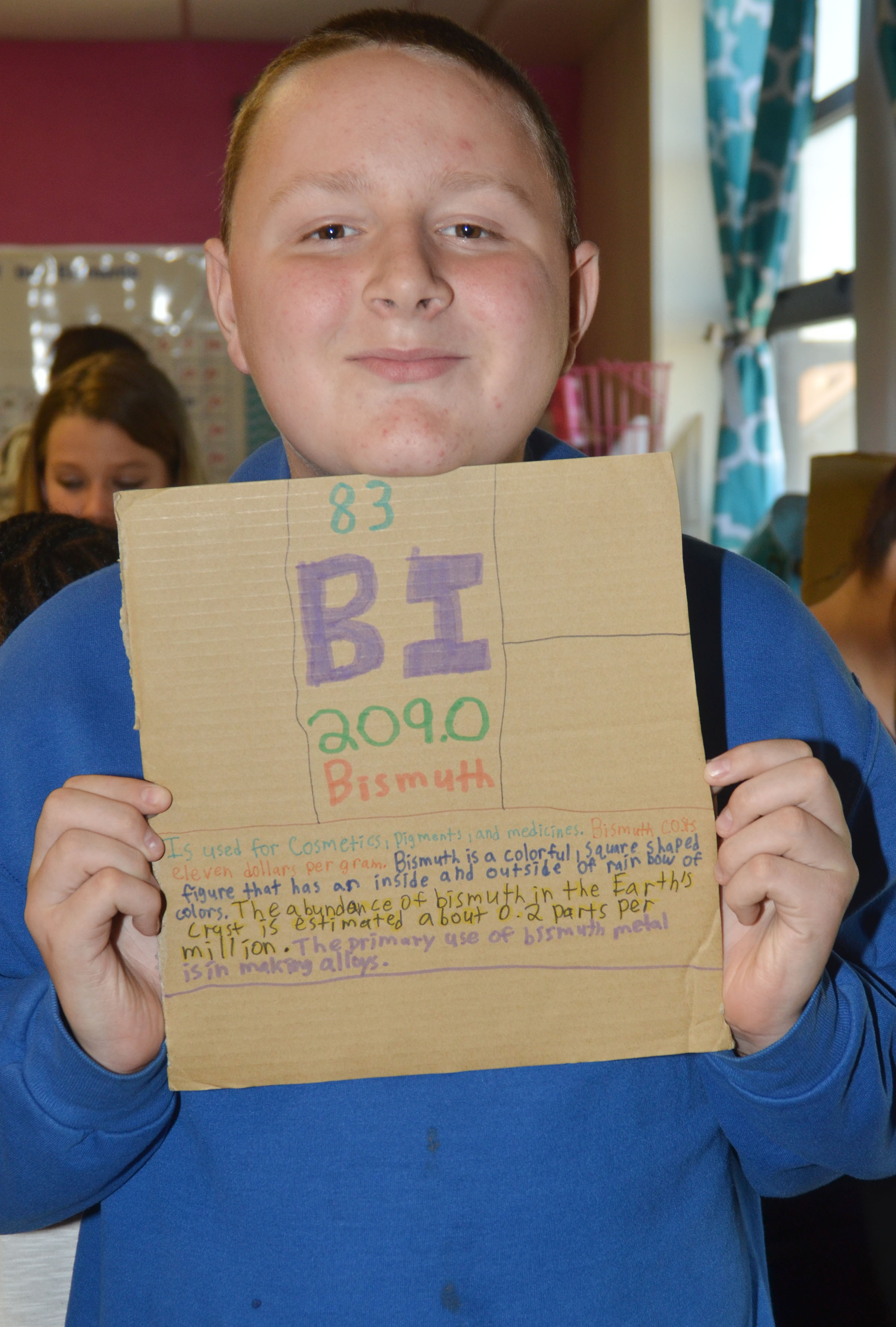 CMS eighth-grader Kylar Cox holds what will become his element box. He chose the element Bismuth.