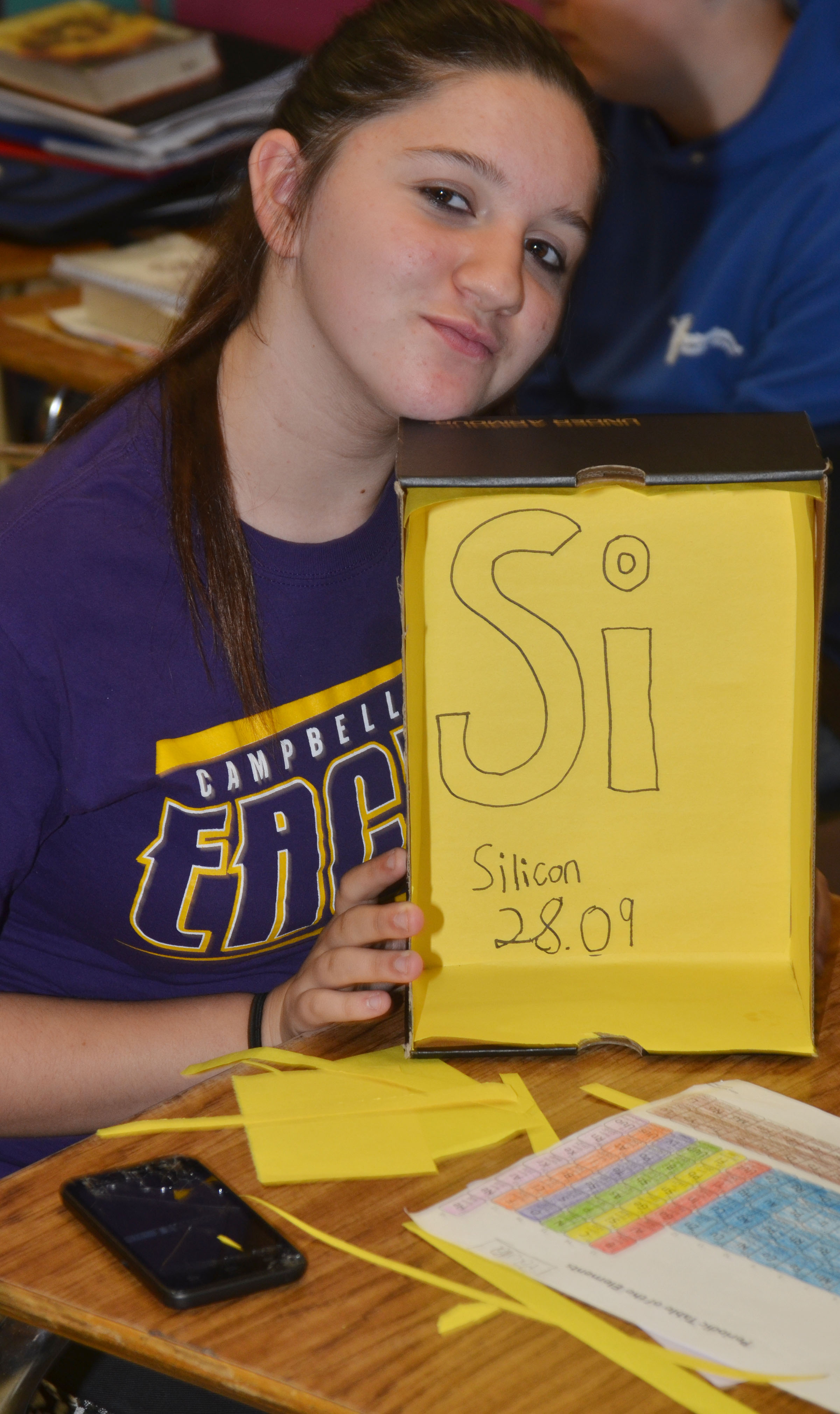 CMS eighth-grader Paula Hoskins shows her nearly complete element box. She chose Silicon.