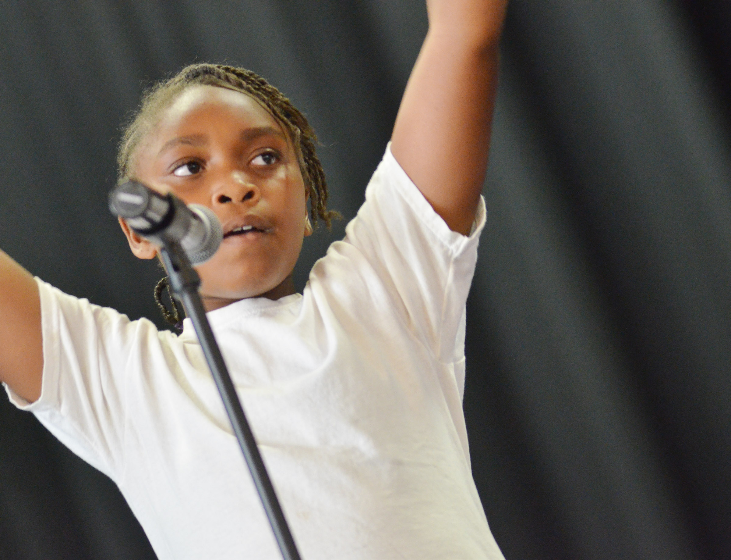 CMS fourth-grader Ta'Zaria Owens sings.