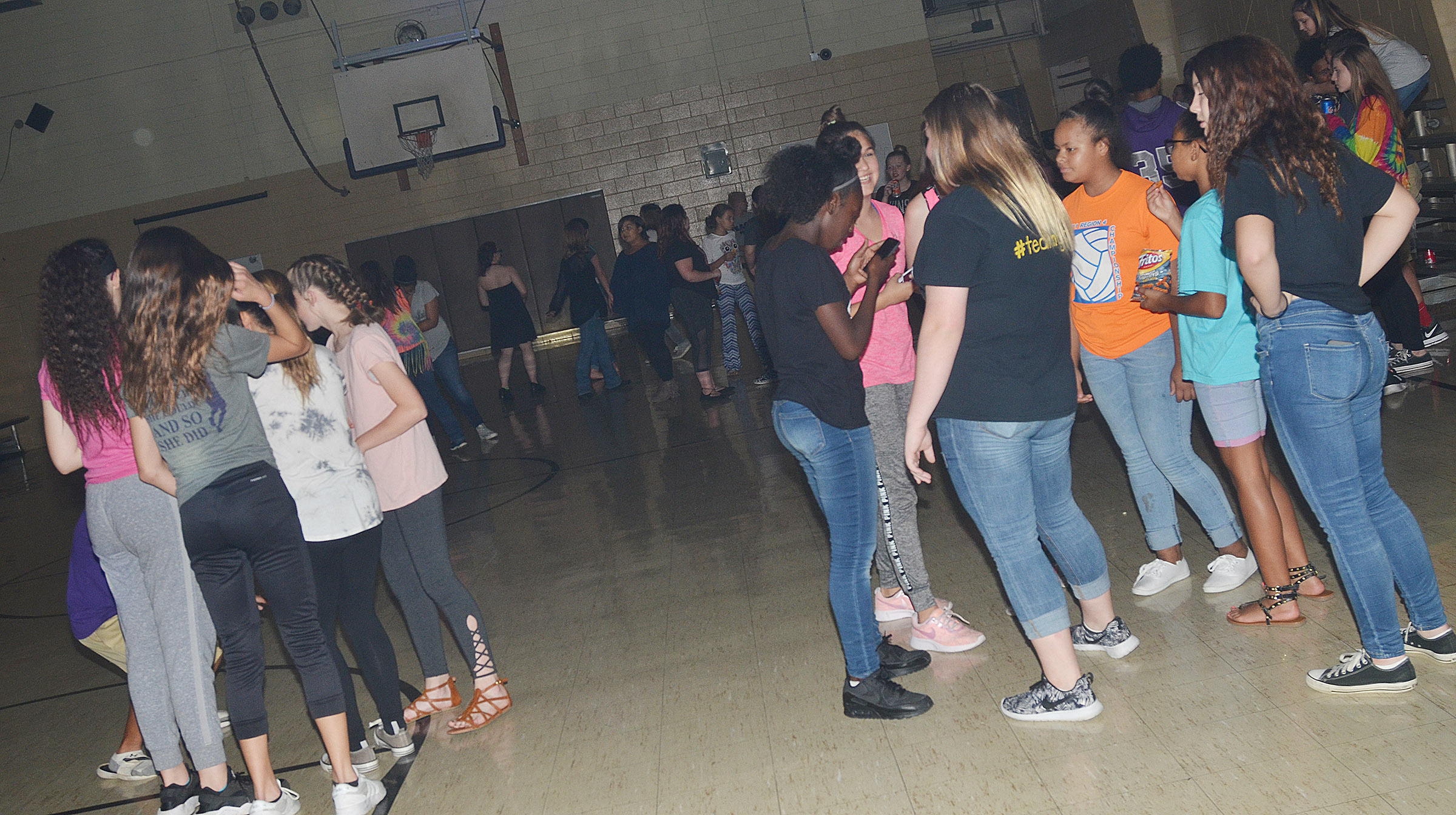 CMS students talk during their fall break dance.