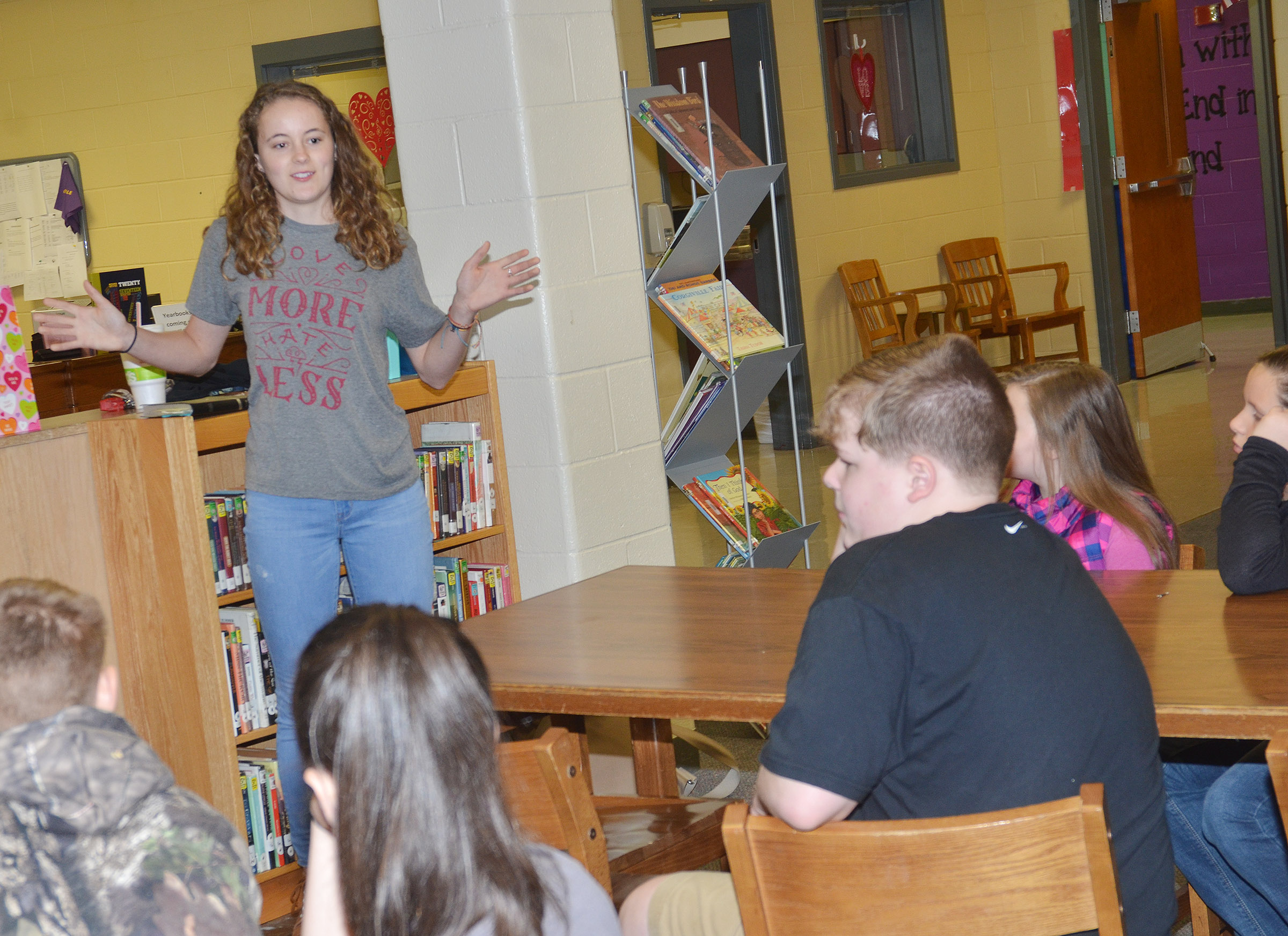 CHS senior Caroline McMahan speaks to CMS FCA students about God's love.