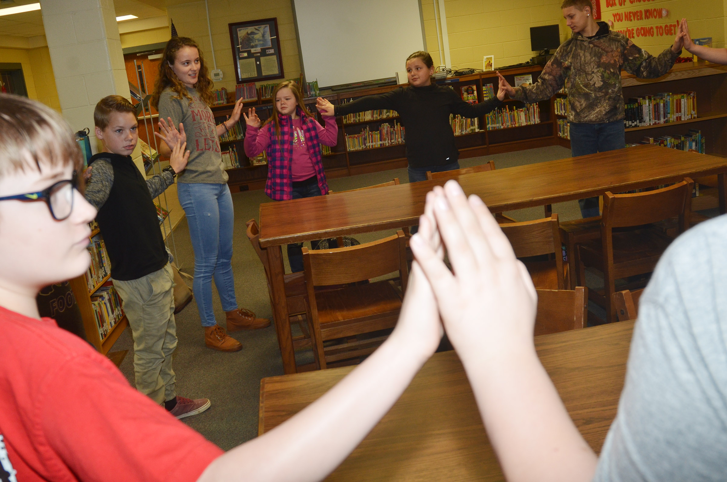 CHS senior Caroline McMahan asks students to join hands to see if any are the same.