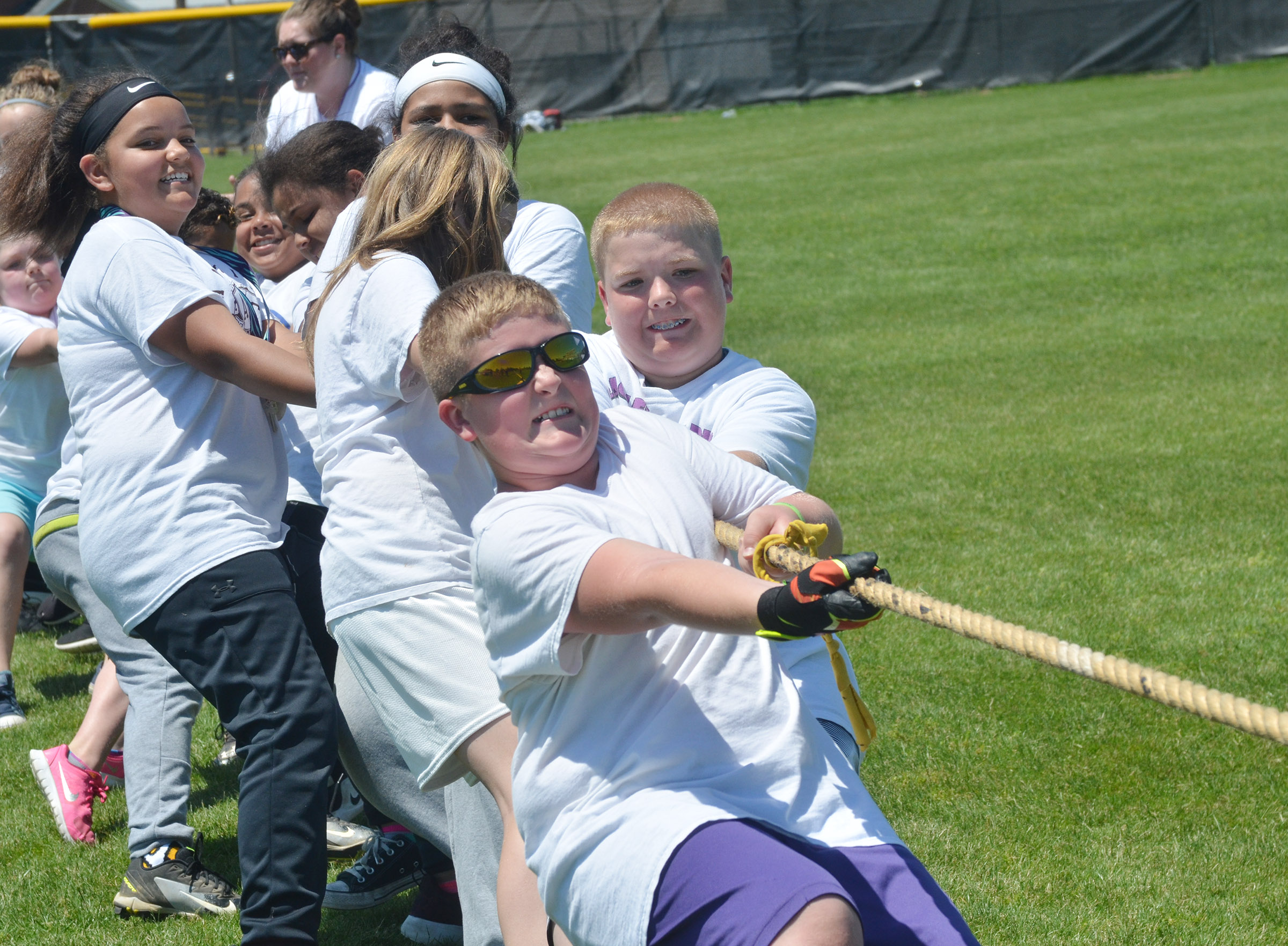 CMS fifth-graders Lance Knifley, at left, and Ryan Grubbs lead their team in tug of war.
