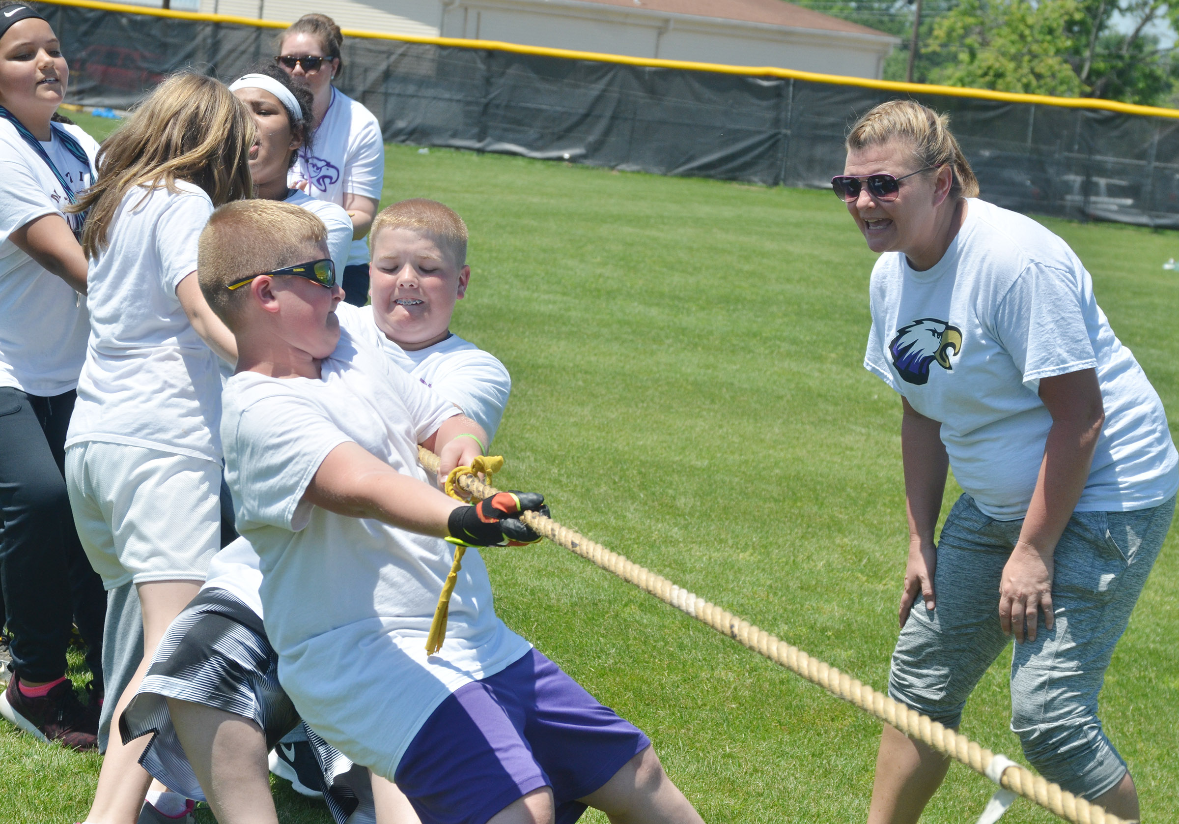CMS fifth-grade teacher Tammy Hash cheers for her students as they compete in tug of war.