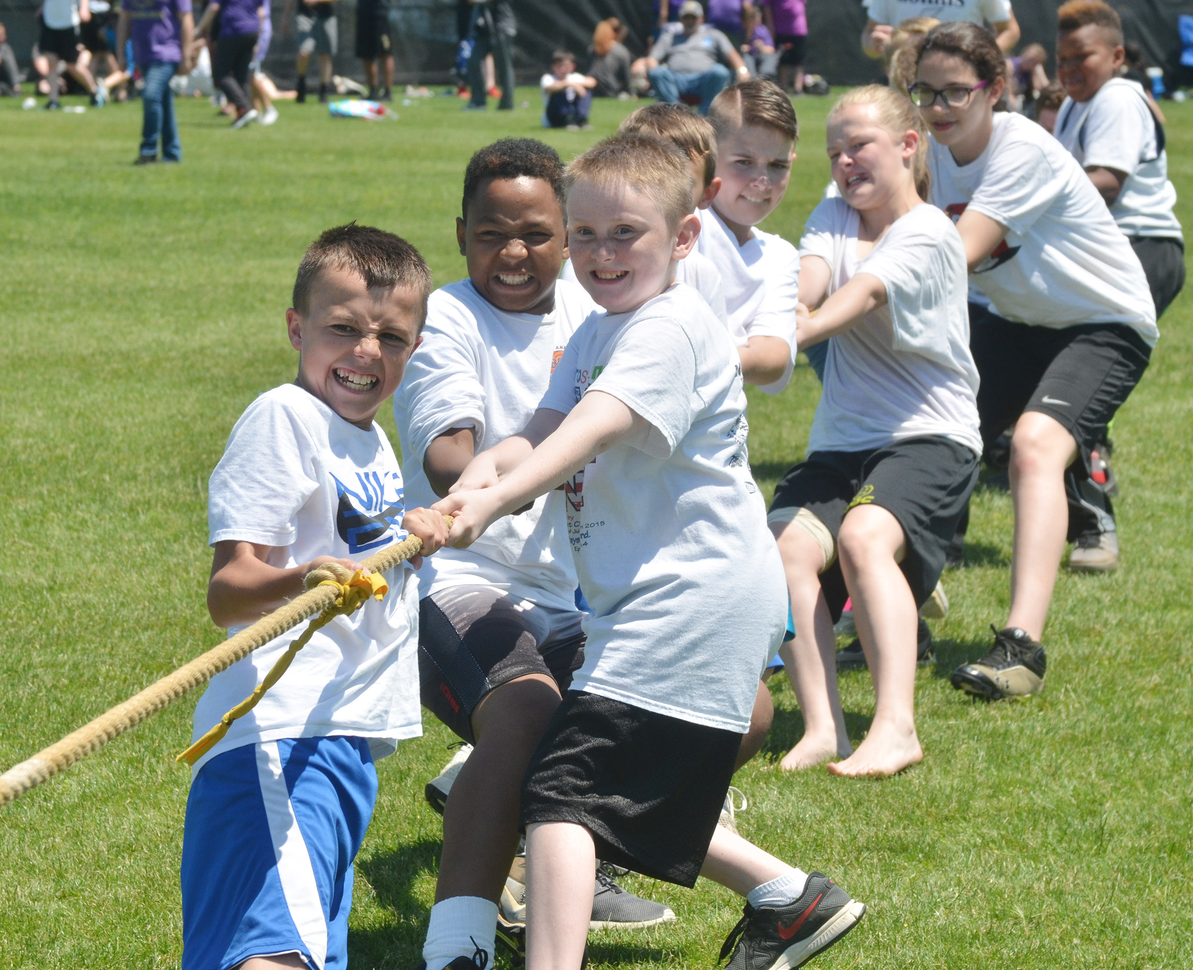 From left, CMS sixth-graders Chase Hord, Deondre Weathers and Zavian McColley lead their classmates in a tug of war battle.