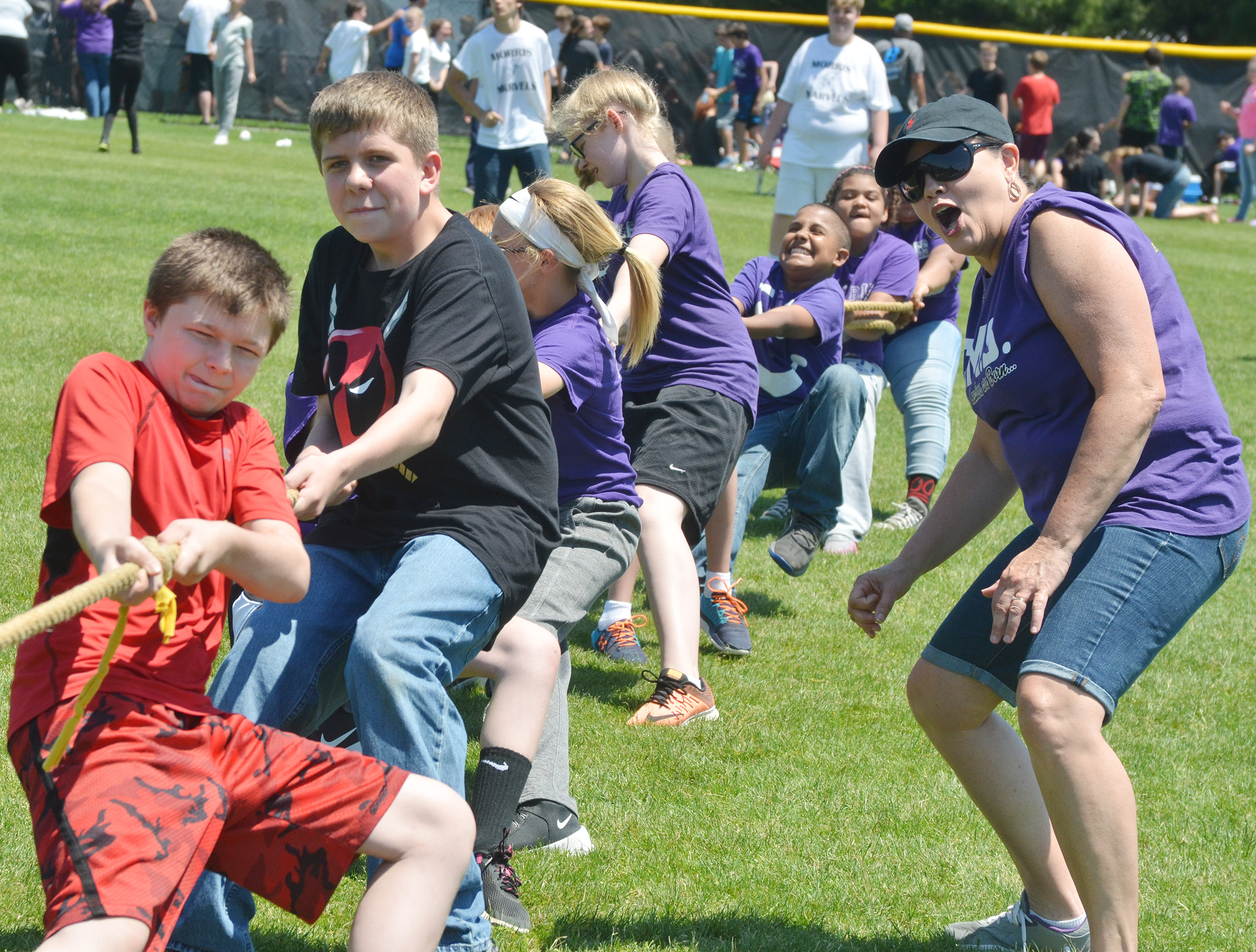 CMS sixth-grade teacher Lisa Kearney cheers for her students as they compete in tug of war.