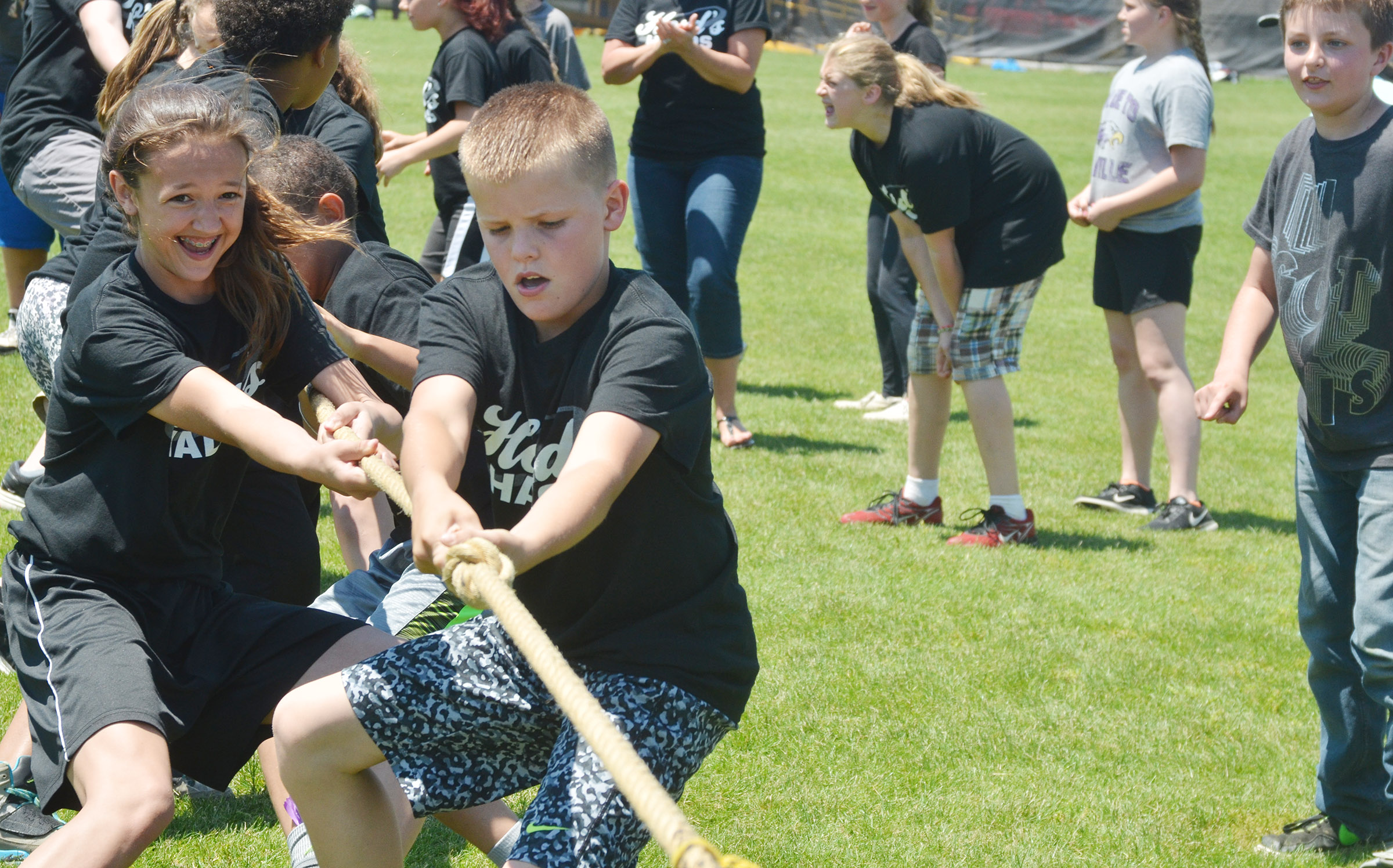 CMS sixth-graders Bri Hayes and Konner Forbis lead their classmates in tug of war.