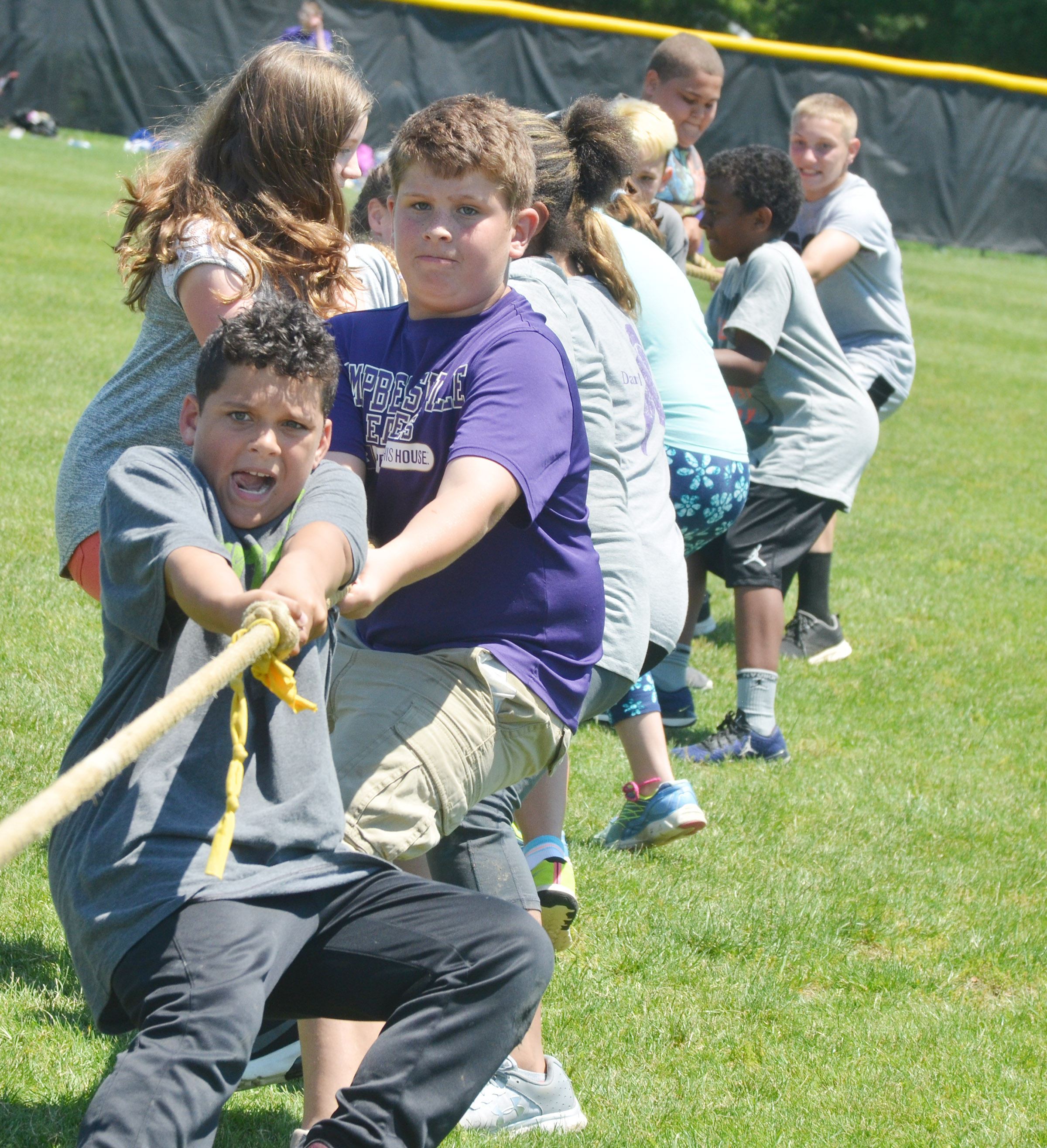 CMS sixth-graders Kaydon Taylor, at left, and Weston Mattingly compete in tug of war.