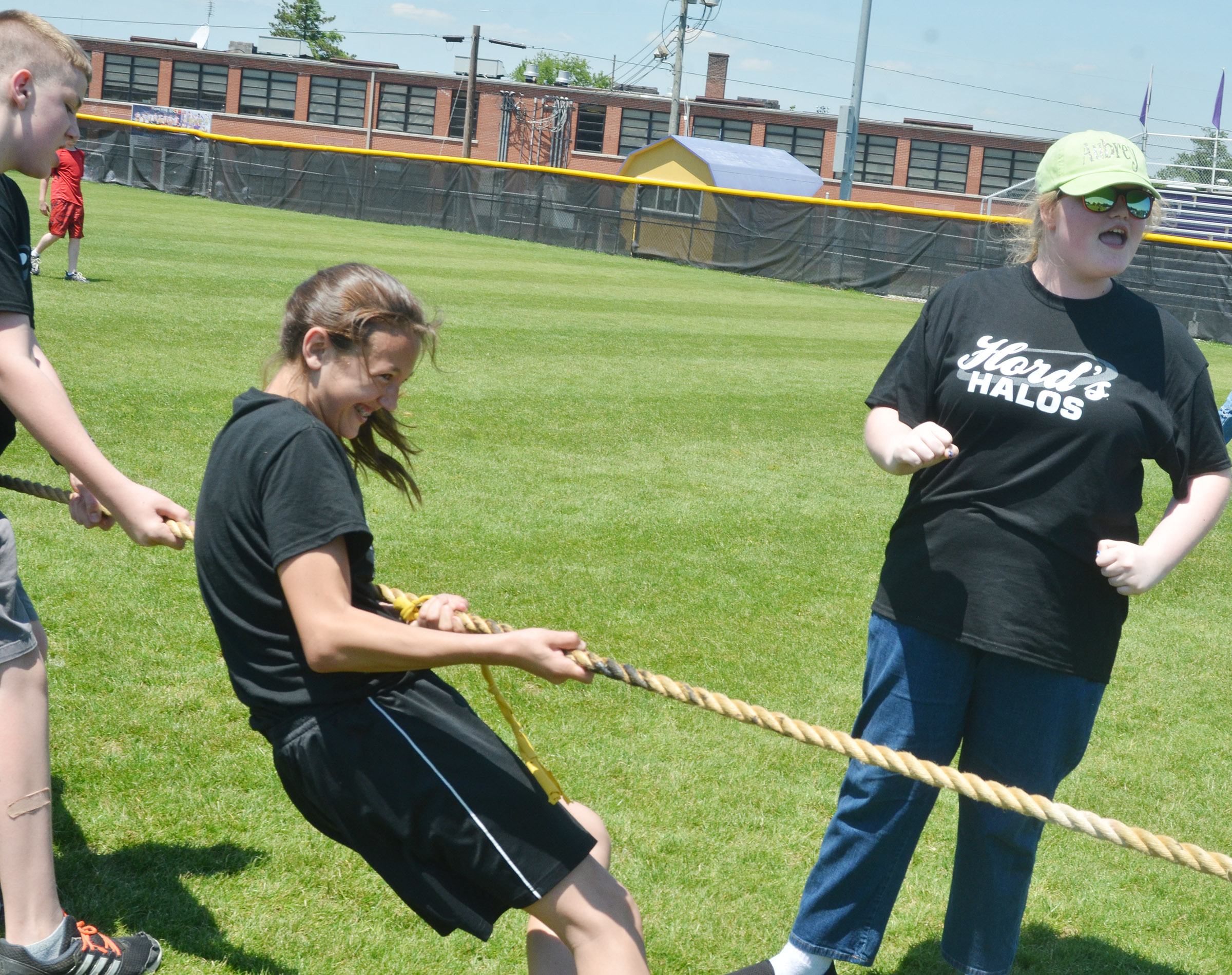 CMS sixth-grader Aubrey Young cheers for her classmates as they compete in tug of war.