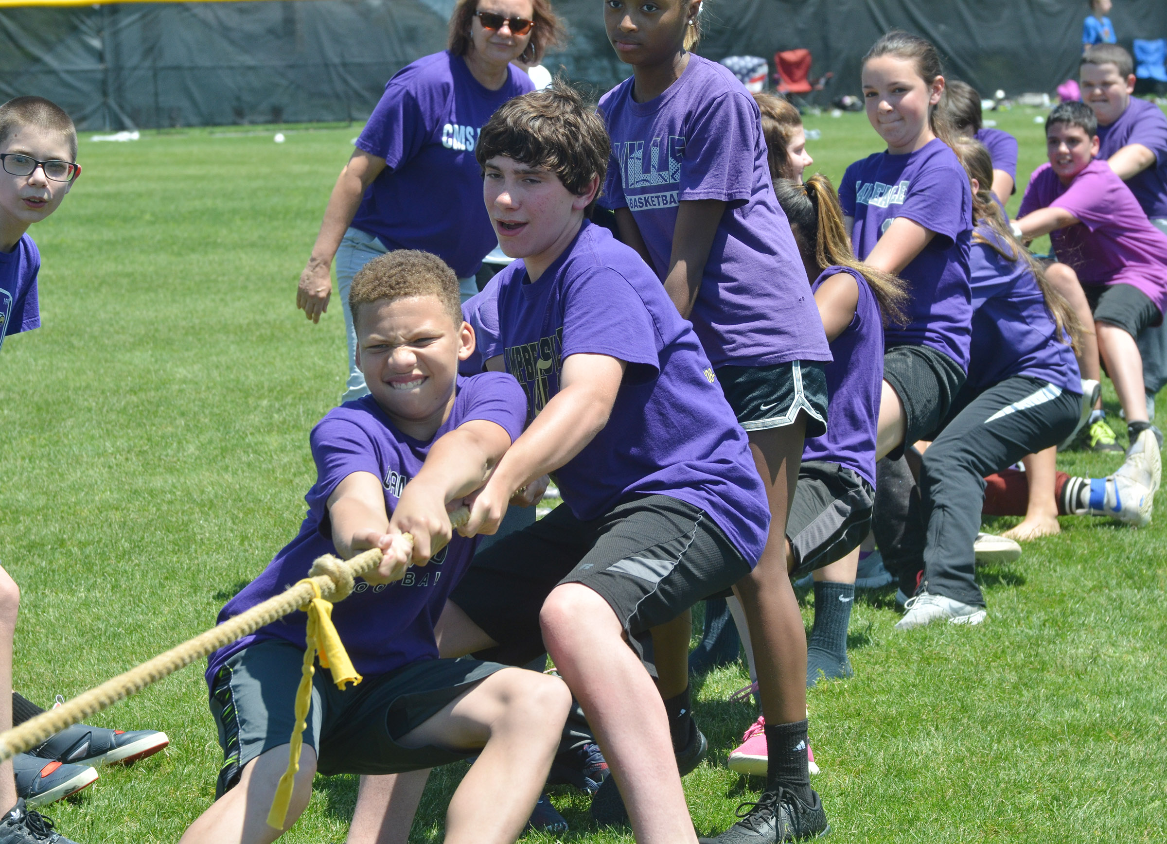 CMS sixth-graders, from left, Dalvian Thornton, Peyton Dabney and Bri Gowdy compete with their classmates in tug of war.