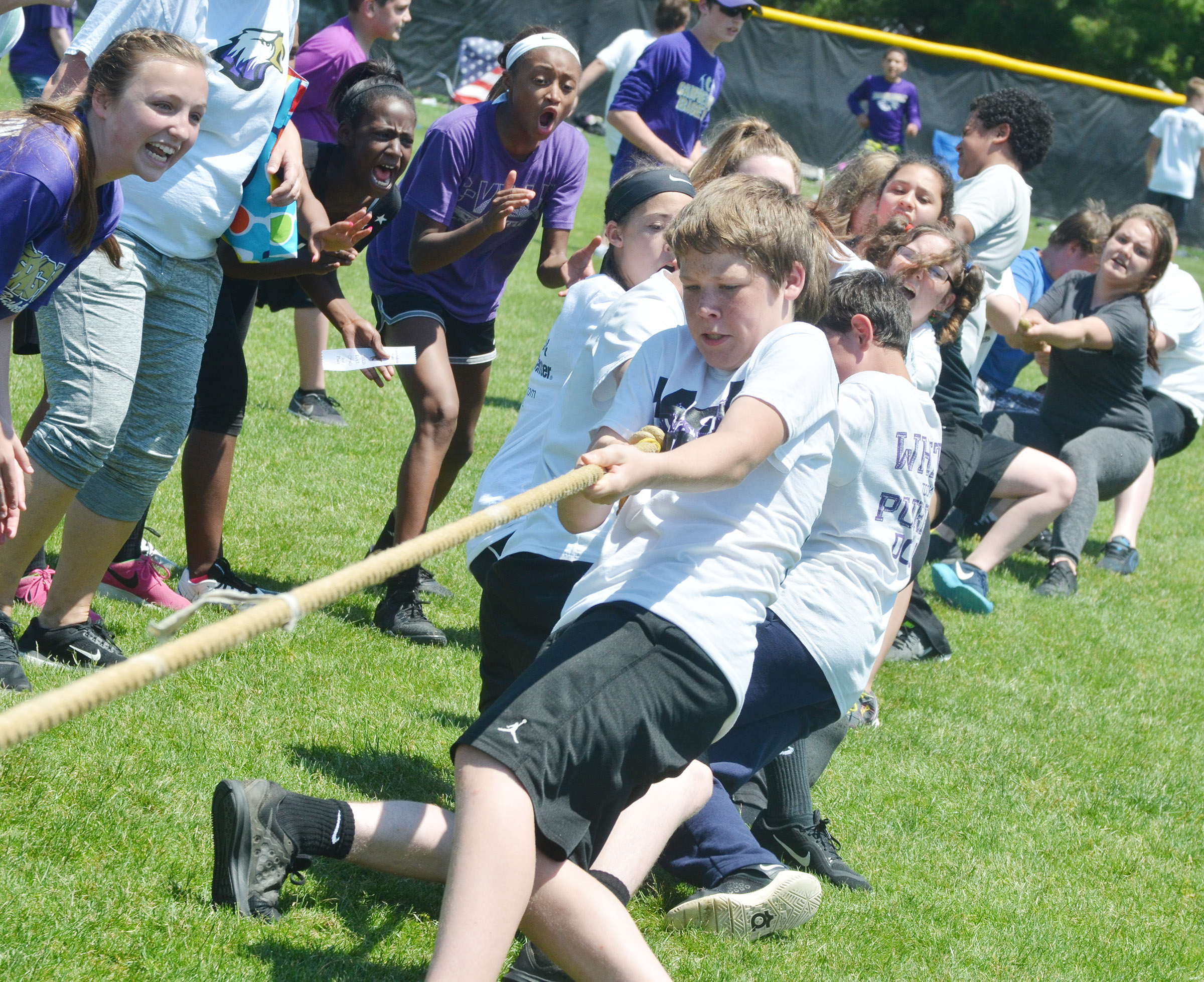 CMS seventh-grader Josh Lucas competes with his classmates in tug of war.