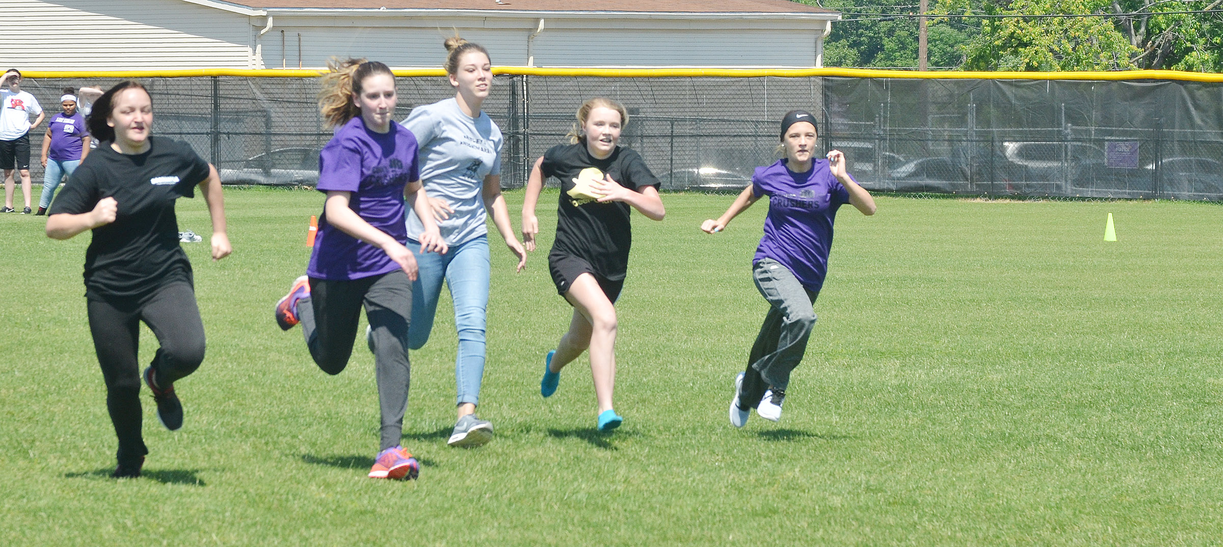 From left, CMS eighth-graders Destiny Hicks, Zoie Sidebottom, Autumn Harvey, Alanna Atwood and Carly Adams run in the 50-yard dash.