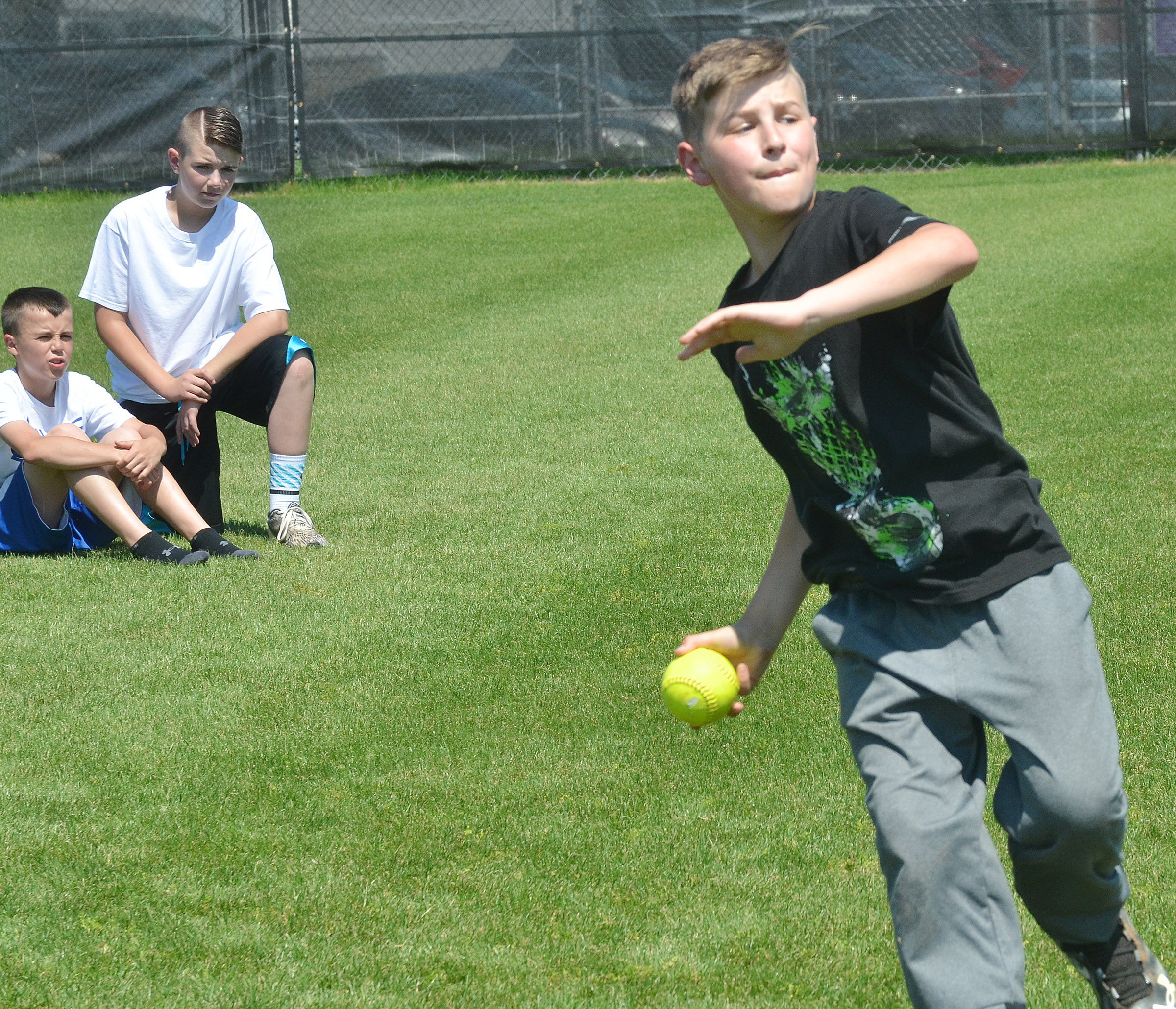CMS fifth-grader Jaxon Sidebottom competes in the softball throw.