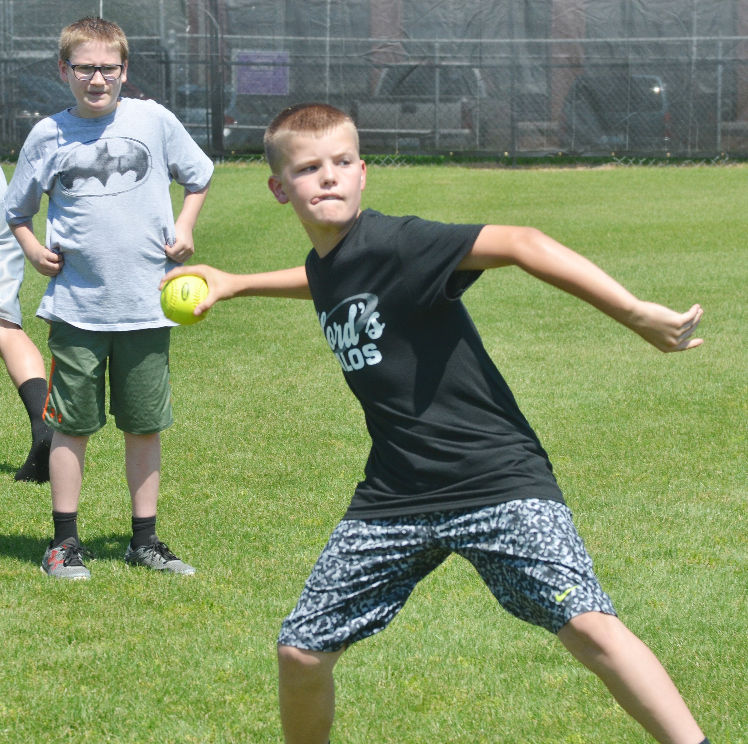 CMS sixth-grader Konner Forbis competes in the softball throw.