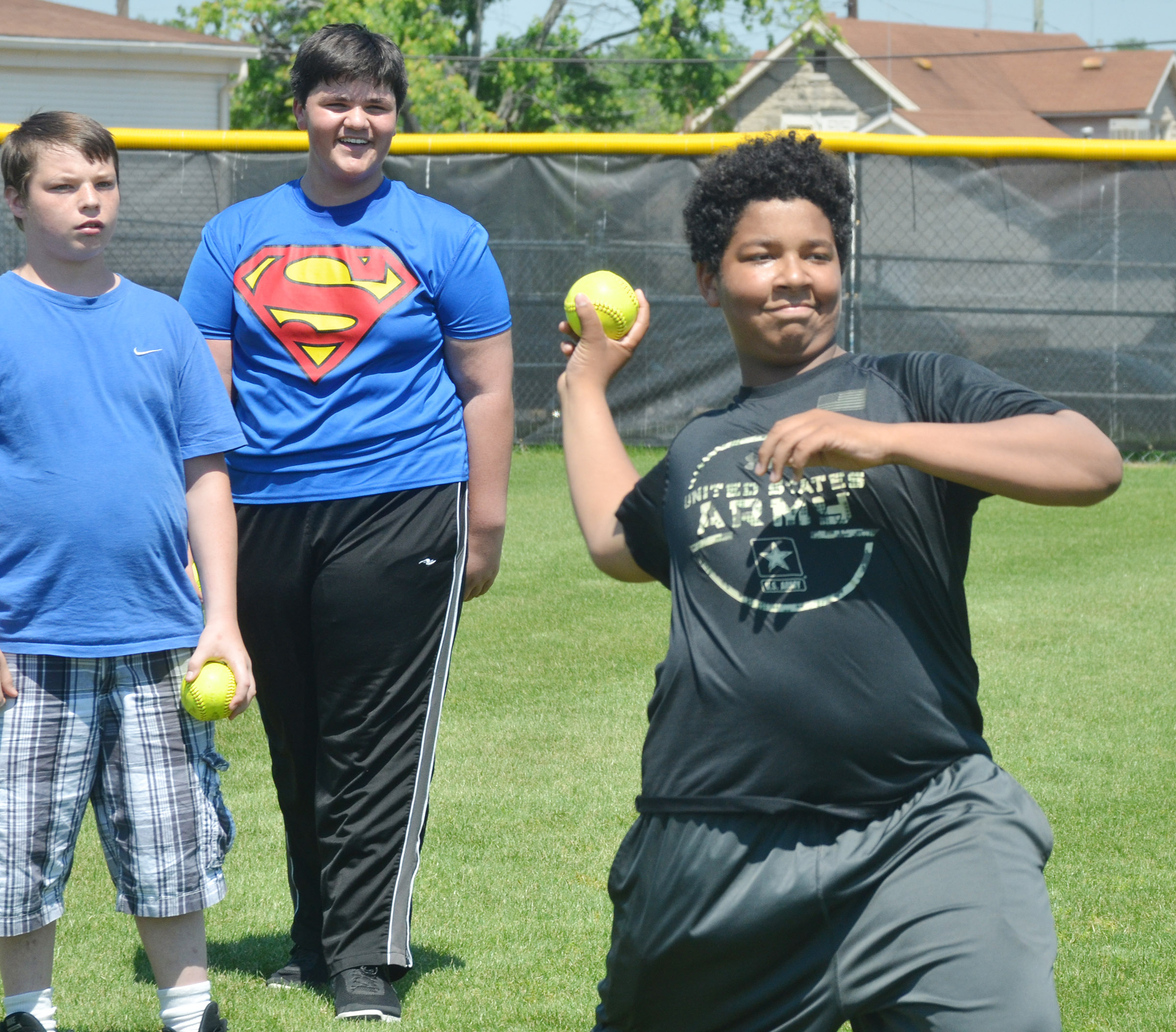 CMS seventh-grader Bryson Karr competes in the softball throw.