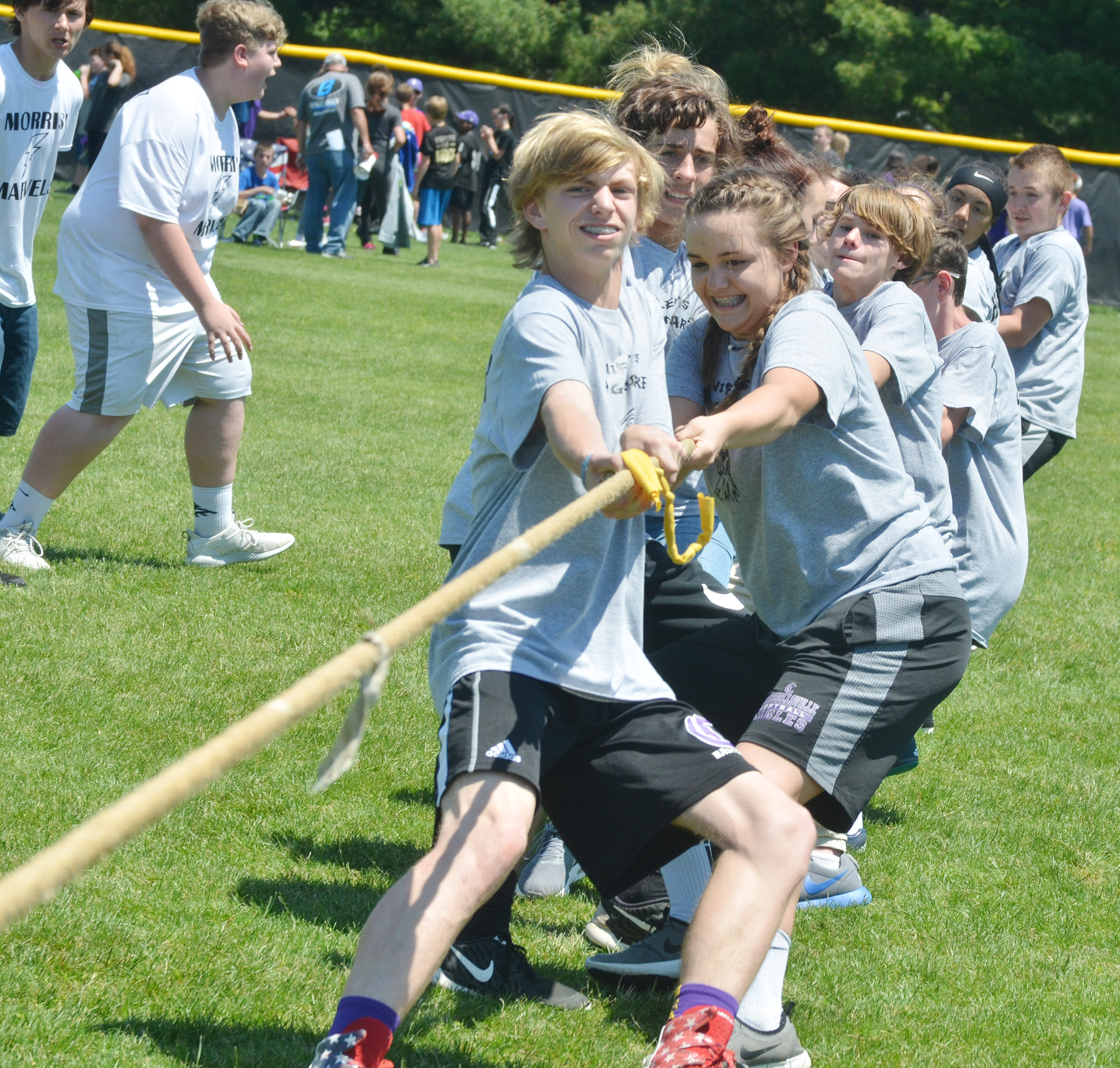 CMS eighth-graders Arren Hash and Kenzi Forbis compete with their classmates in tug of war.