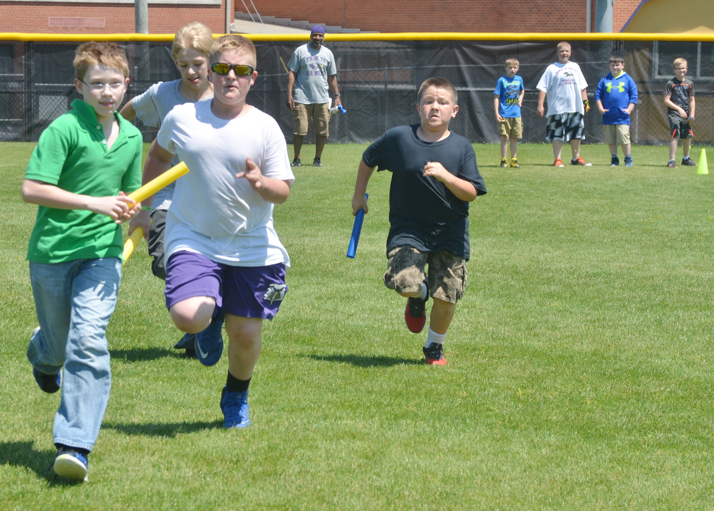 From left, CMS fifth-graders Willie Nunn, Jacob Releford, Lance Knifley and Leo Lamer run in the 4x4 relay race.