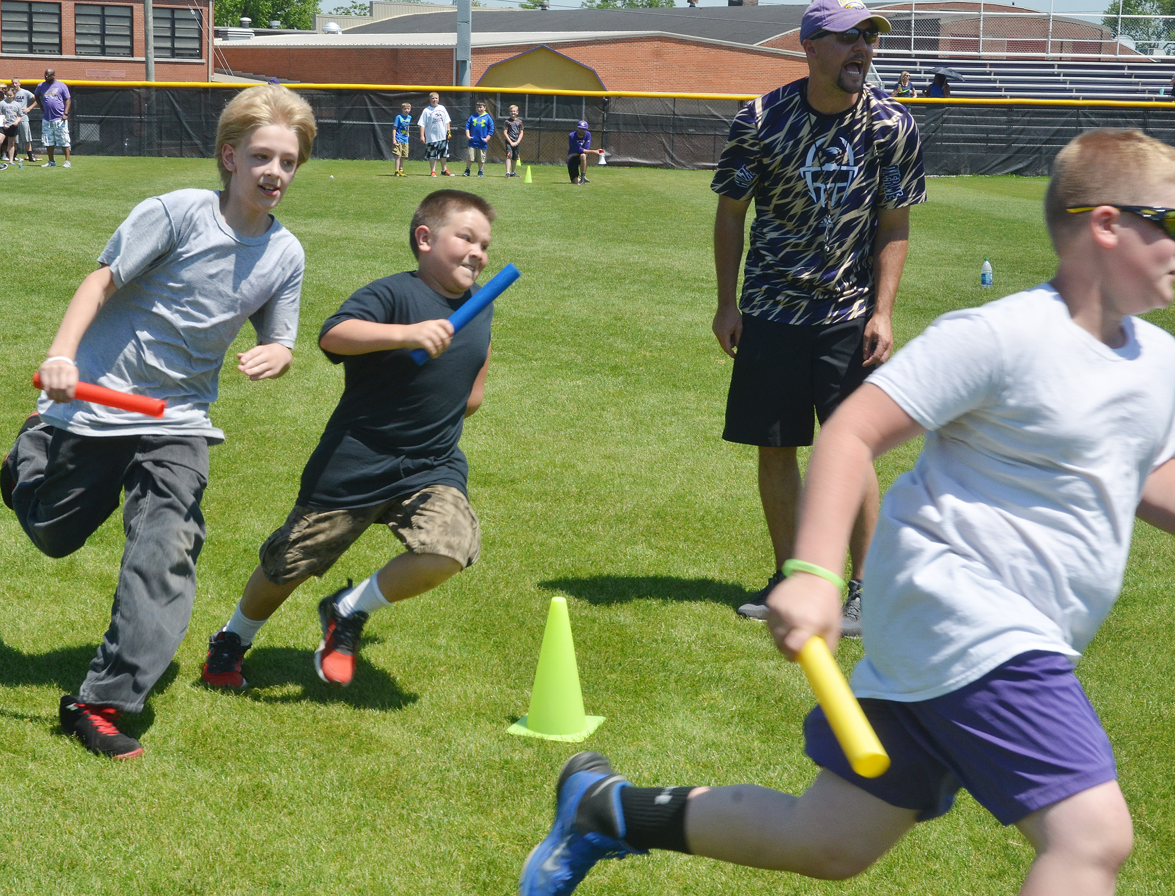 From left, CMS fifth-graders Jacob Releford, Leo Lamer and Lance Knifley compete in the 4x4 relay race.
