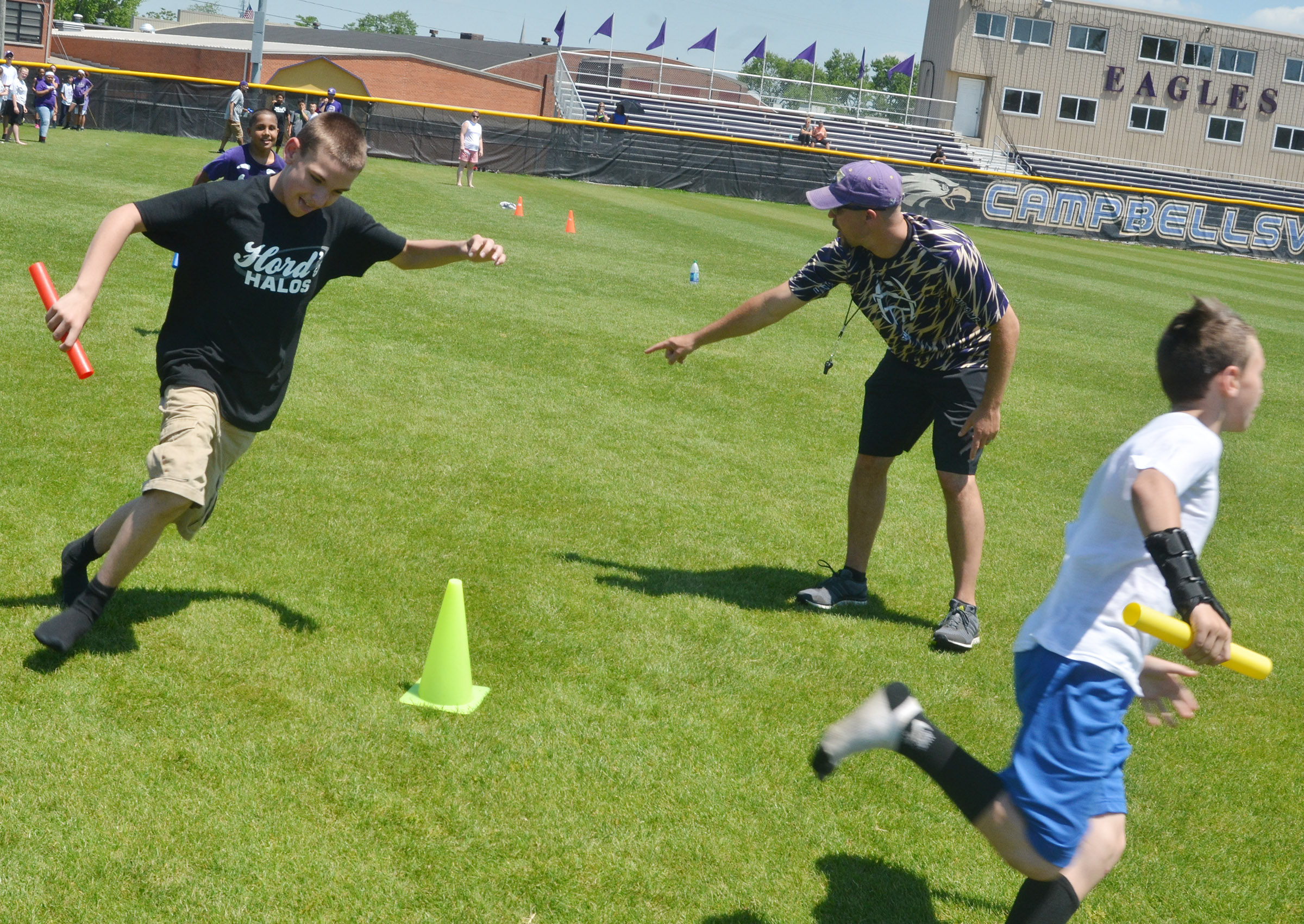 CMS sixth-grader Nate Mitchell and his classmates run in the 4x4 relay race.