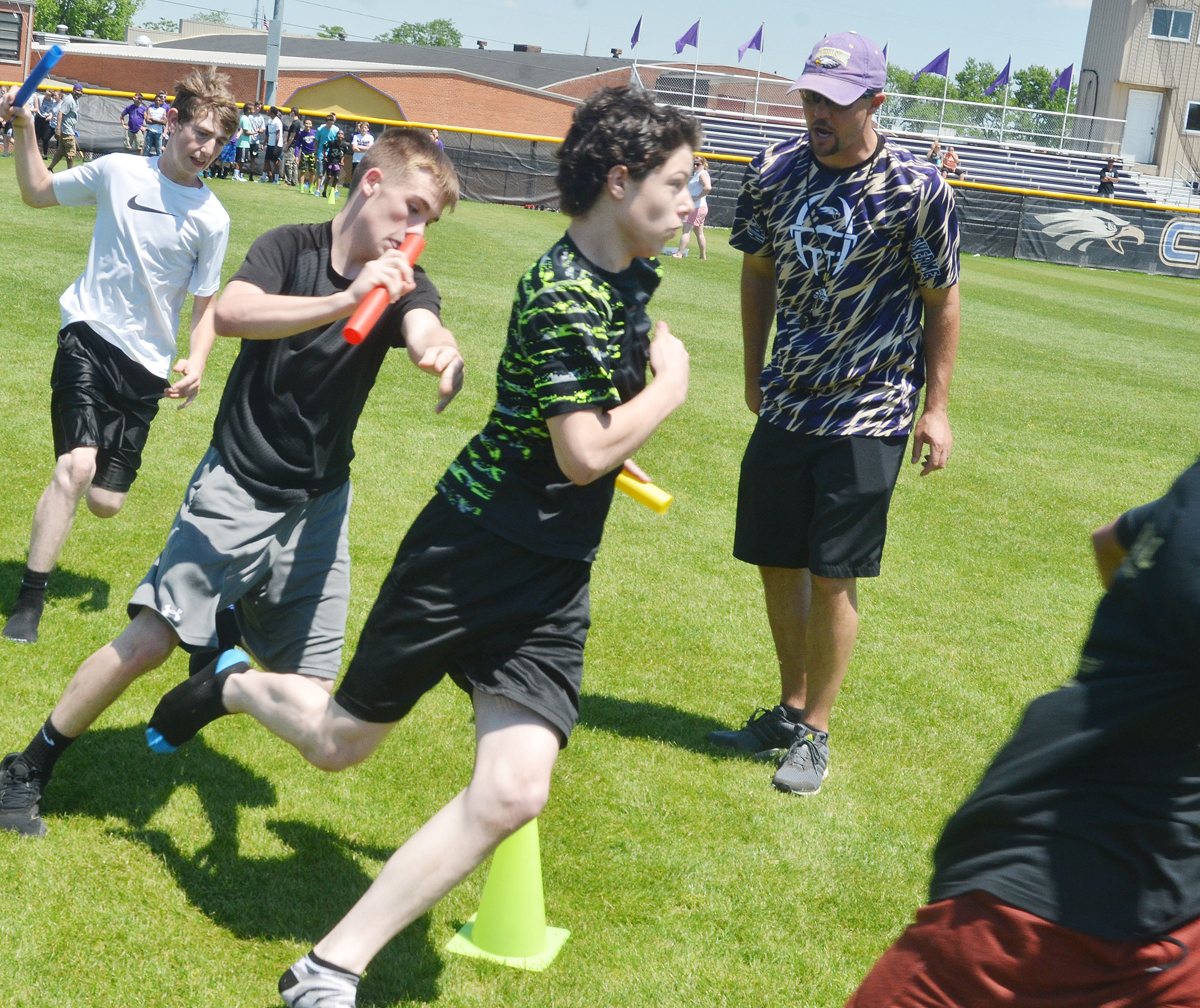 From left, CMS seventh-graders Waylon Franklin, Levi Sallee and C.J. Adams run in the 4x4 relay race.