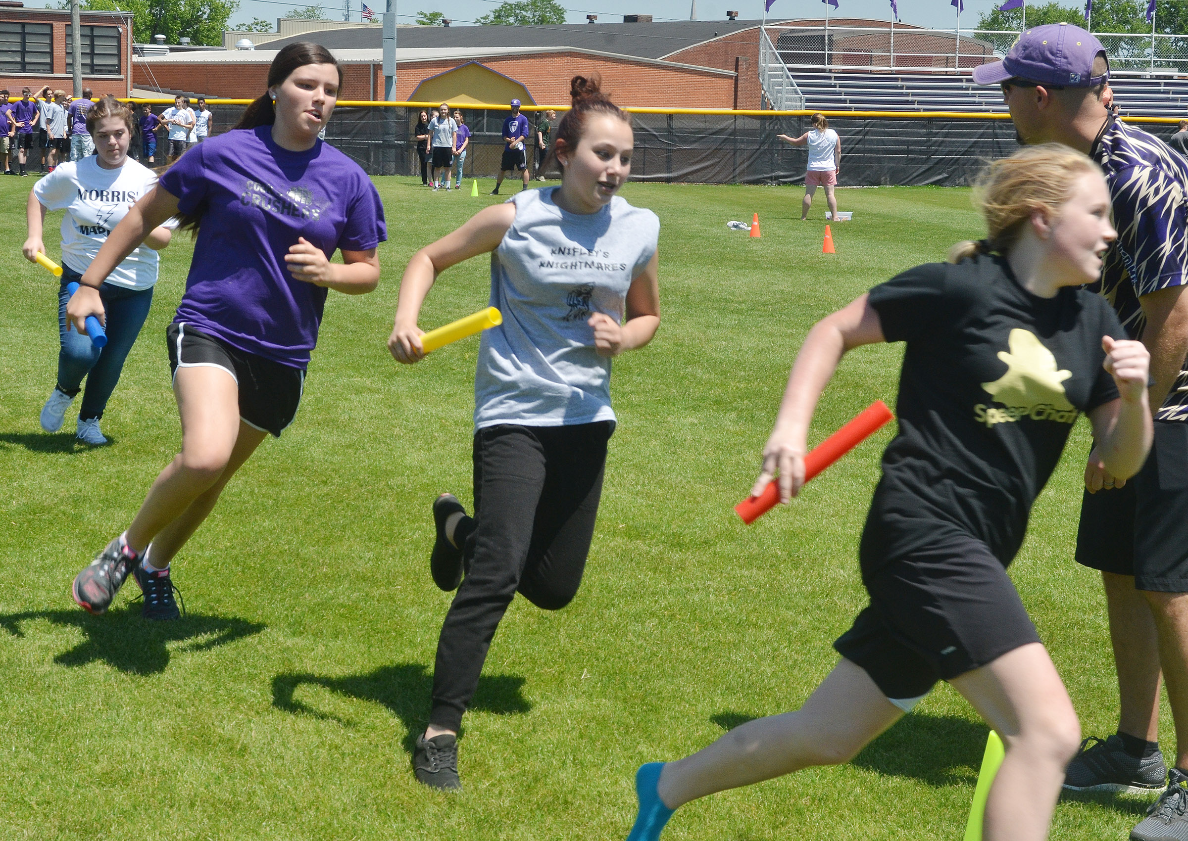 CMS eighth-graders, from left, Chloe Garrett, Hannah Keith, Victoria Garcia and Alanna Atwood run in the 4x4 relay race.
