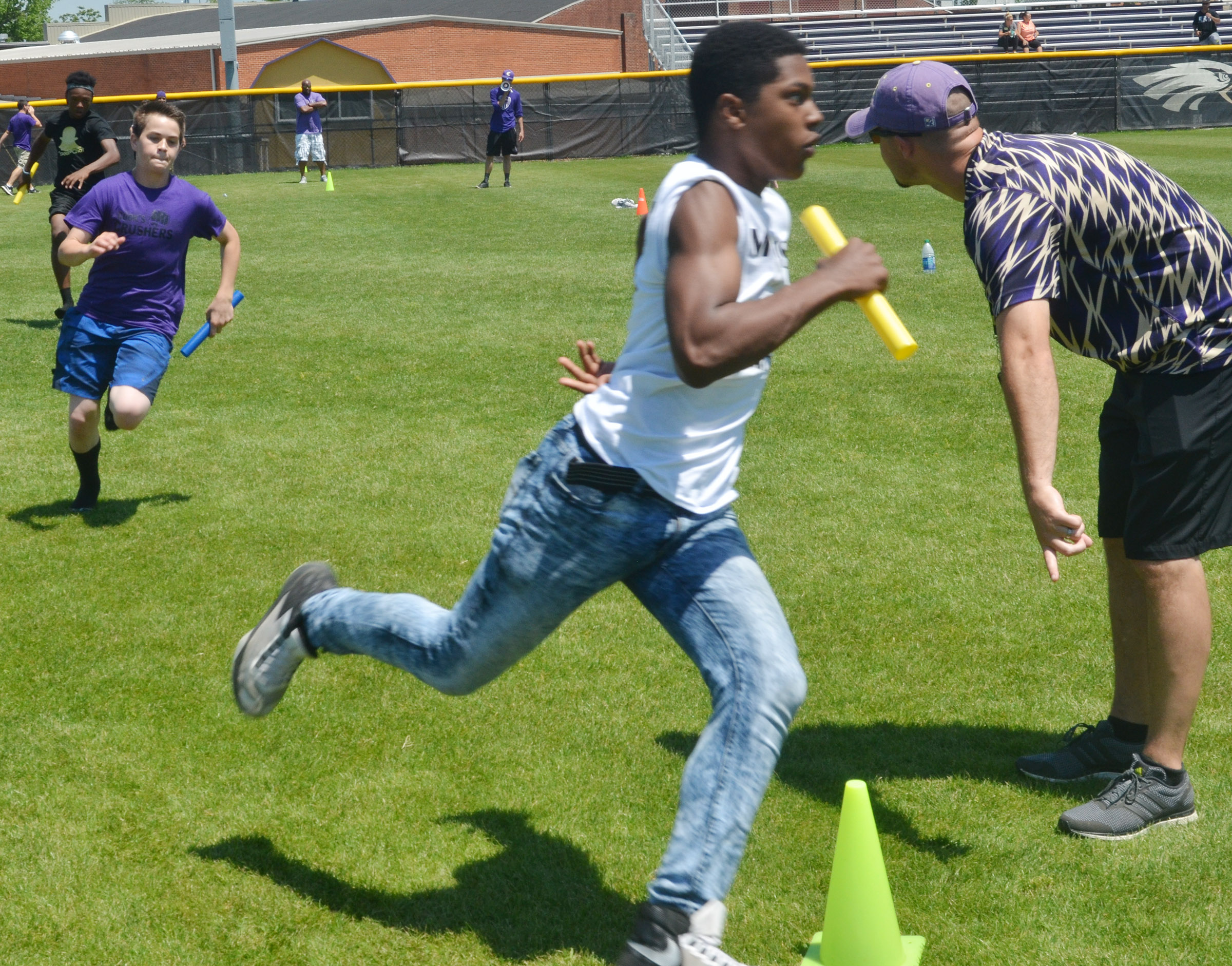 CMS eighth-grader Clark Kidwell, at left, tries to catch classmate Zaquan Cowan in the 4x4 relay race.