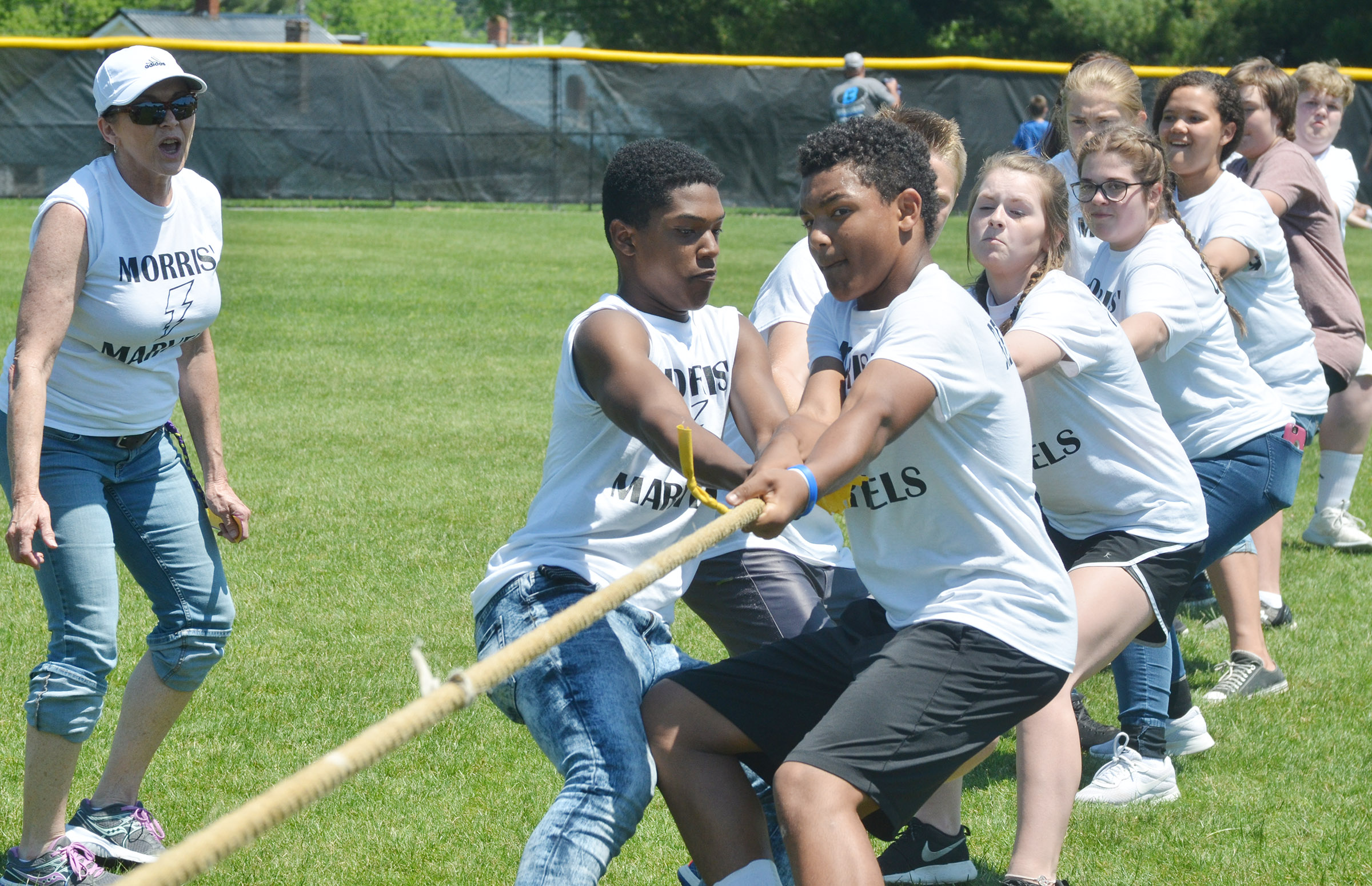 CMS eighth-grade teacher Melisa Morris cheers for her students as they compete in tug of war.