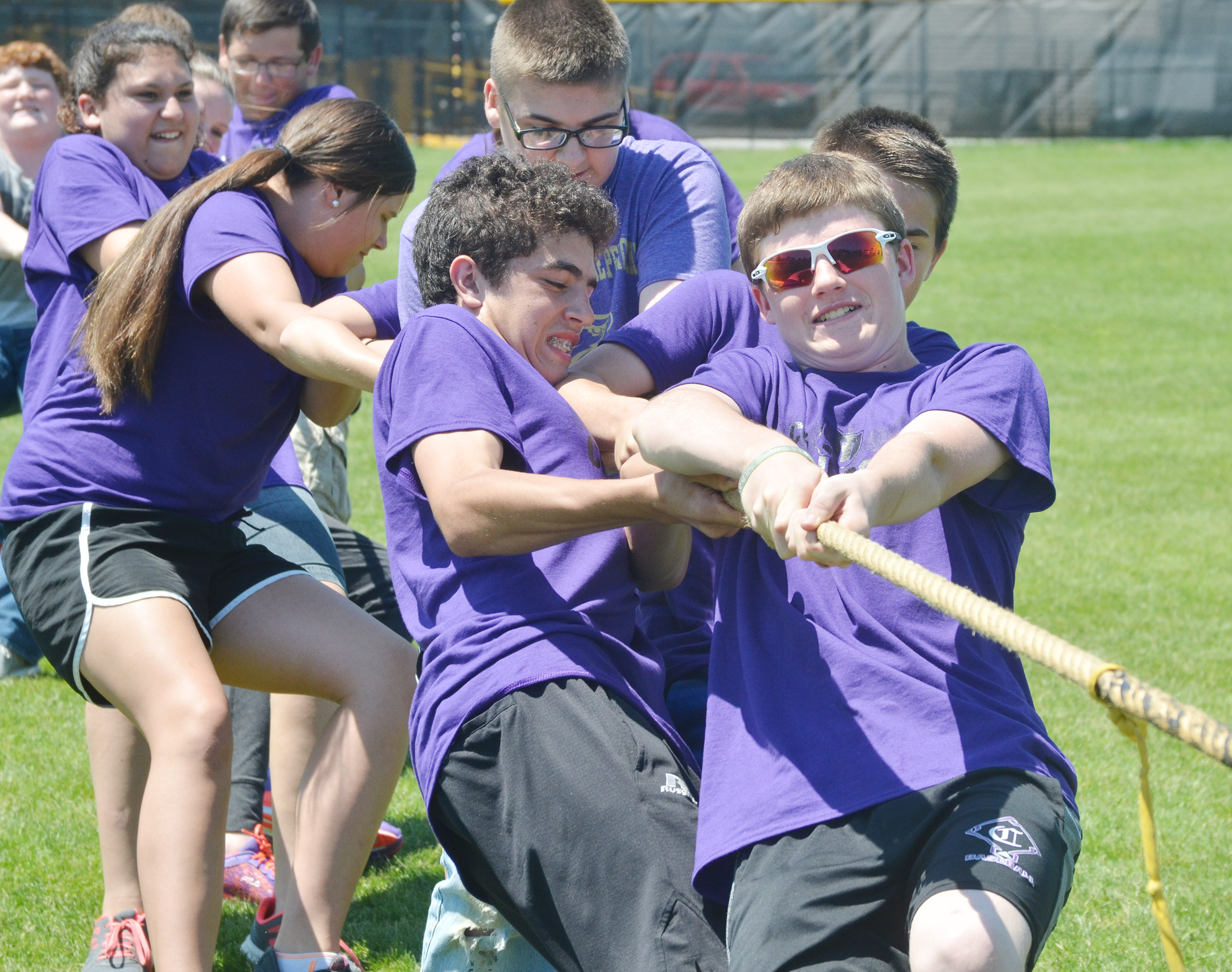 CMS eighth-graders Kameron Smith, at left, and Tristin Faulkner compete with their classmates in the tug of war competition.