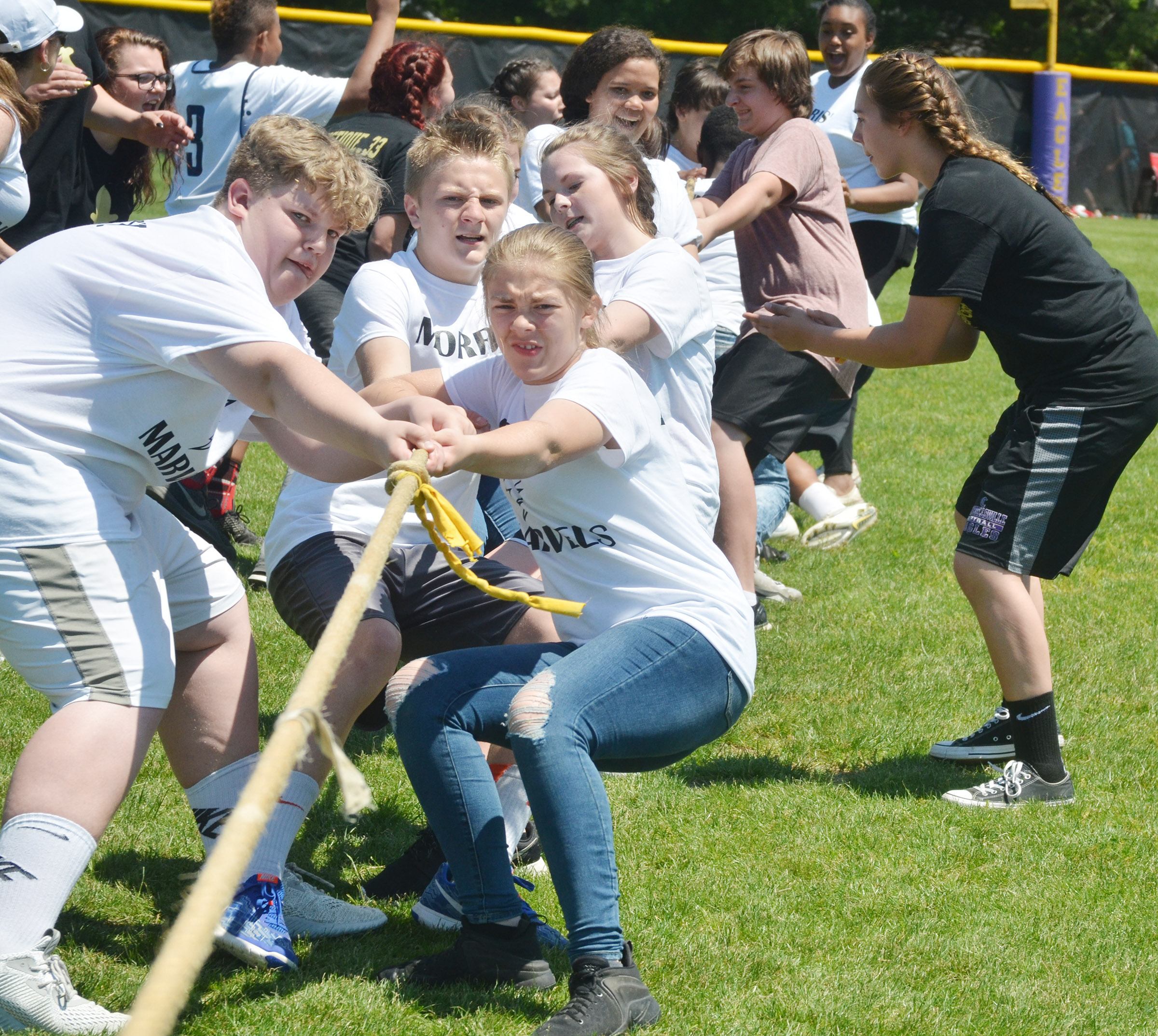 CMS eighth-graders Noah Mardis, at left, and Emily Kerns lead their classmates as they compete in the tug of war battle.