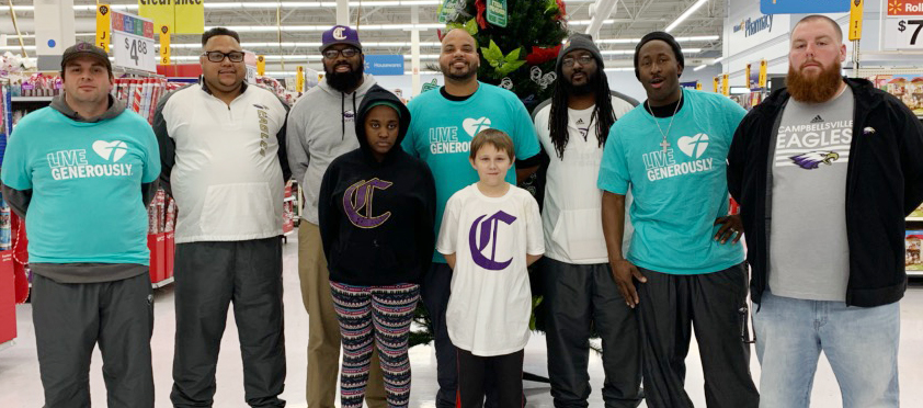 CMS football coaches recently partnered with Thrivent financial consultants firm to purchase Christmas gifts for two deserving students. Pictured with sixth-graders Jazzmin Coulter and James Pennington are, from left, assistant coaches Tommy Allen, Bronson Gowdy and Will Griffin, head coach Aaron Webb and assistant coaches Shumari Bridgewater, John Gholston and Stephen Tucker.