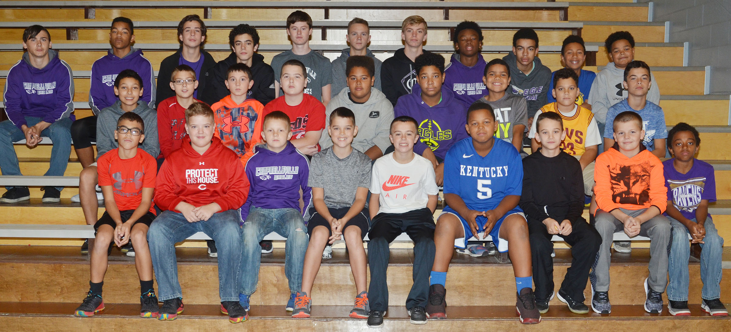 CMS boys' basketball players are honored at Friday Finish.