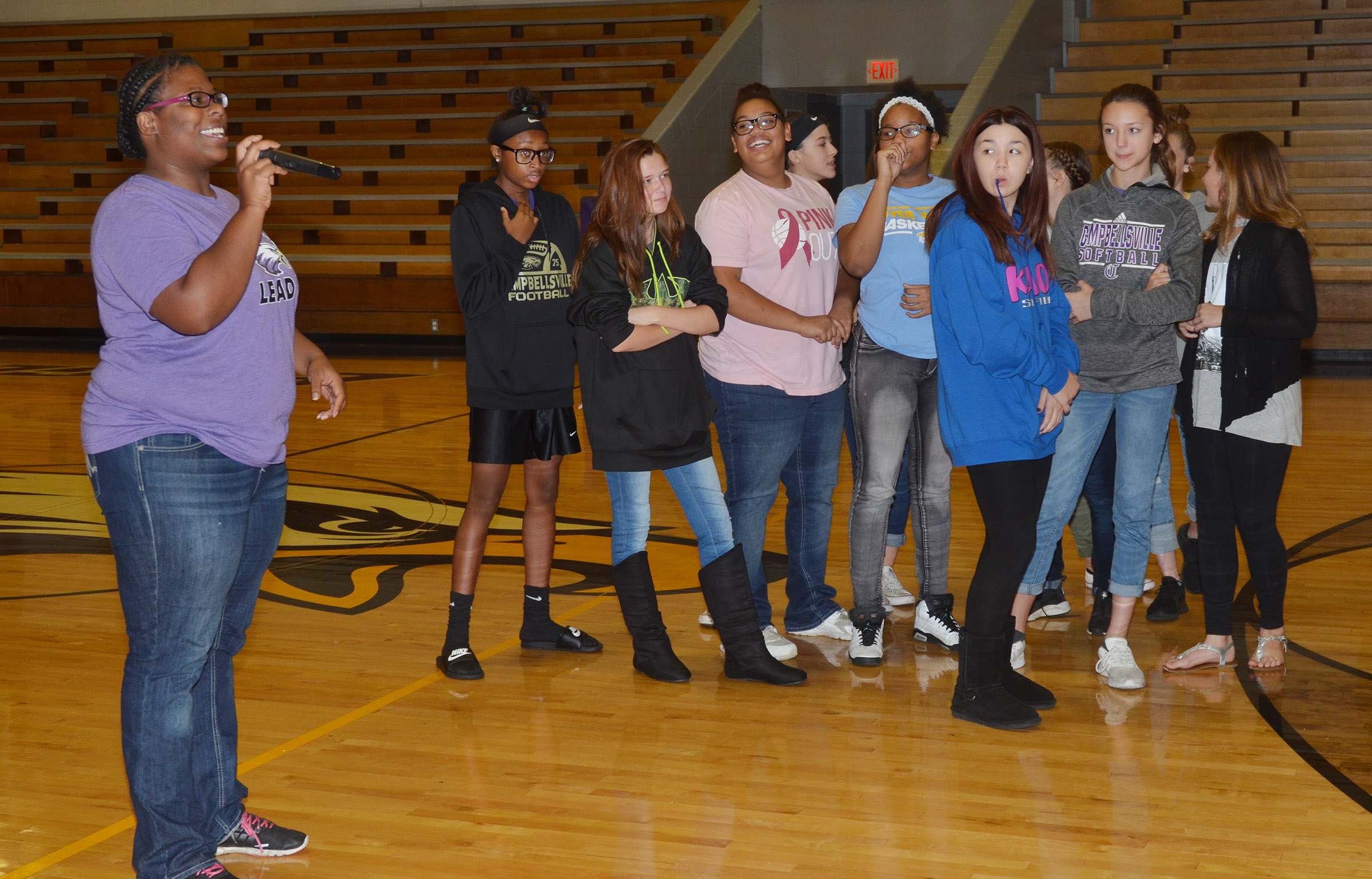 CMS girls' basketball head coach Tiarra Cecil recognizes her players, who recently won the Central Kentucky Middle School Athletic Conference eighth-grader championship for the first time in 20 years.