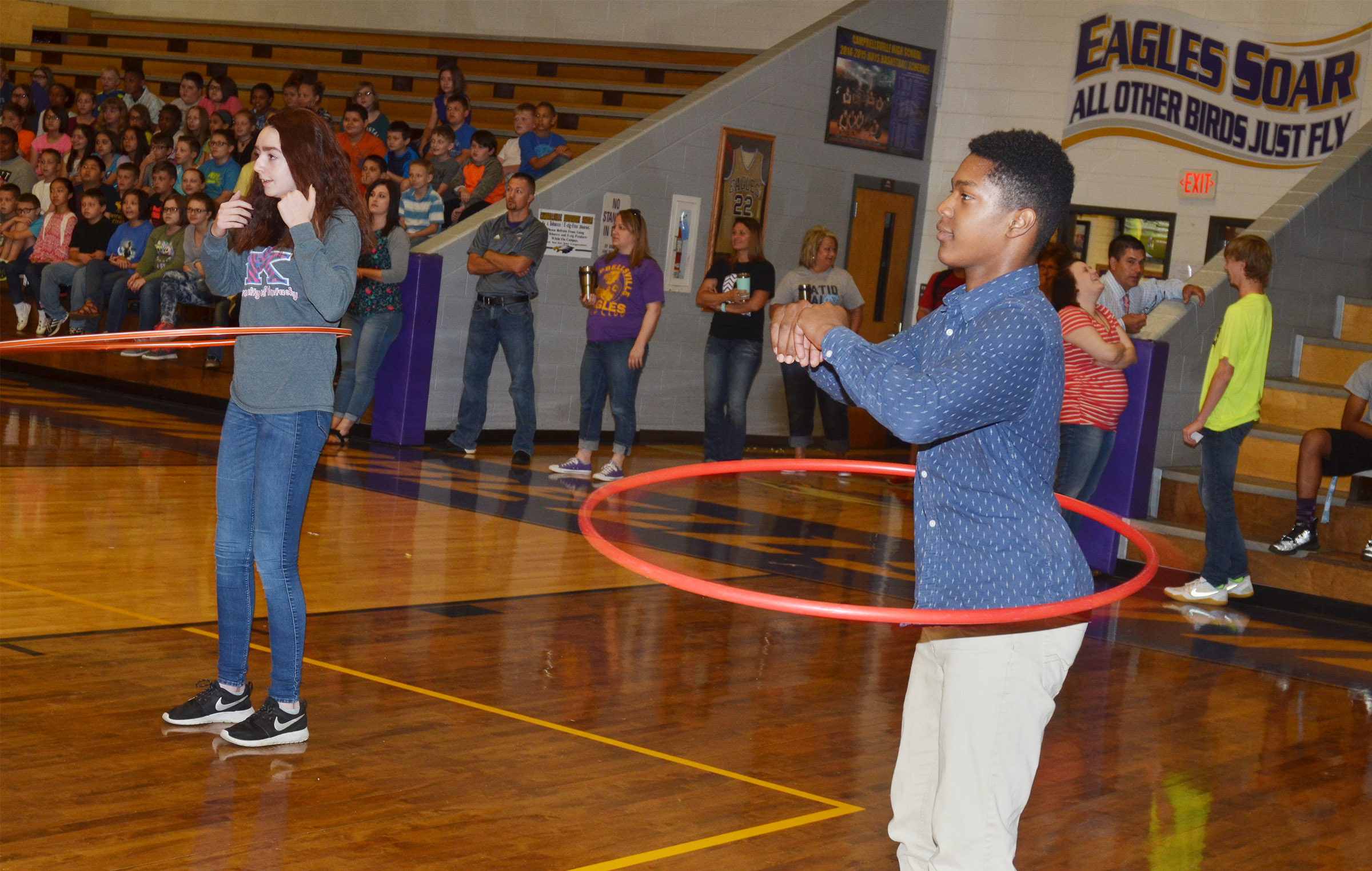 CMS eighth-grader Zaquan Cowan competes against classmate Winter Mershon.