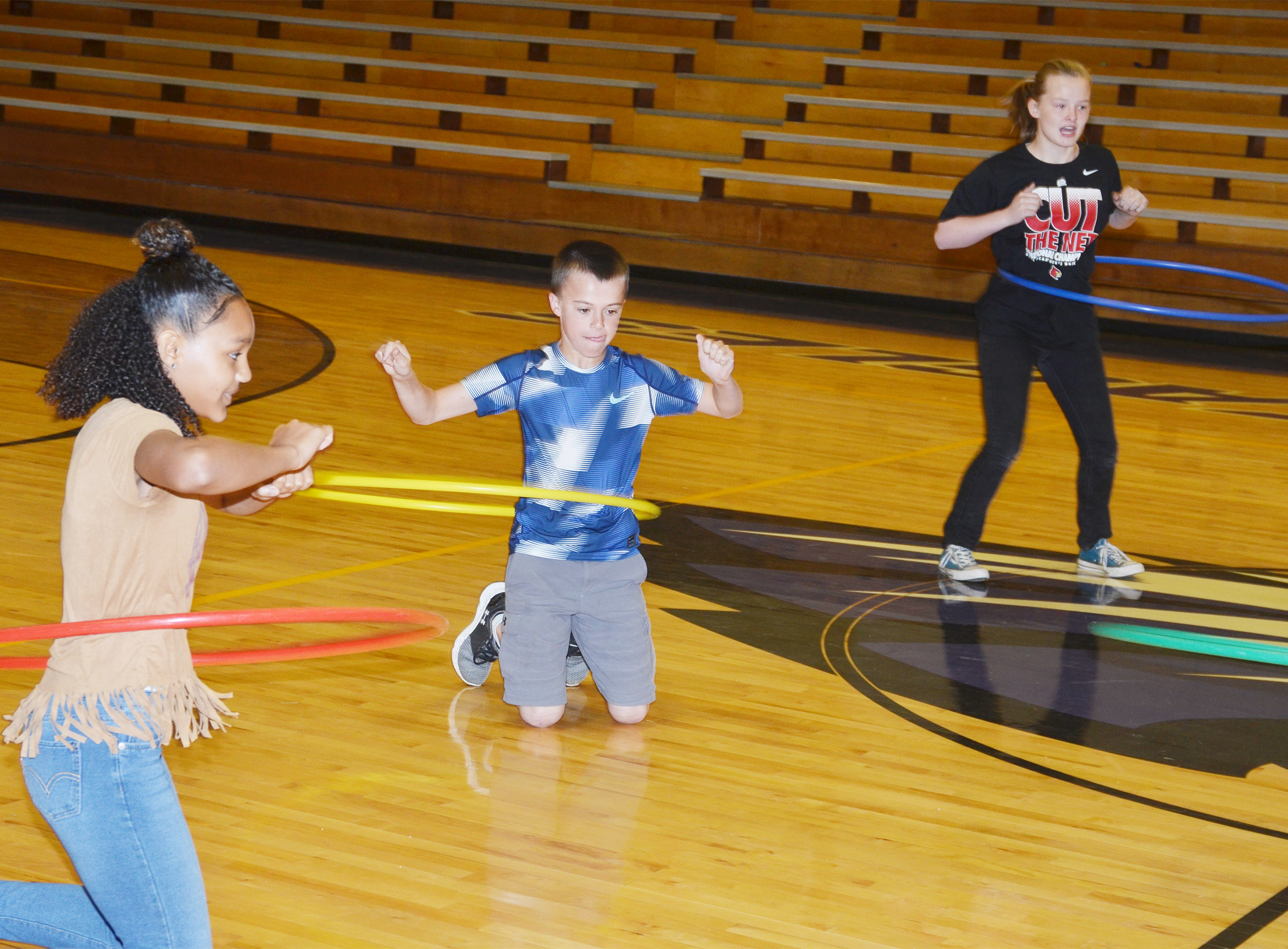 From left, CMS seventh-grader Alexis Thomas and sixth-graders Chase Hord and Davanna Reardon compete.