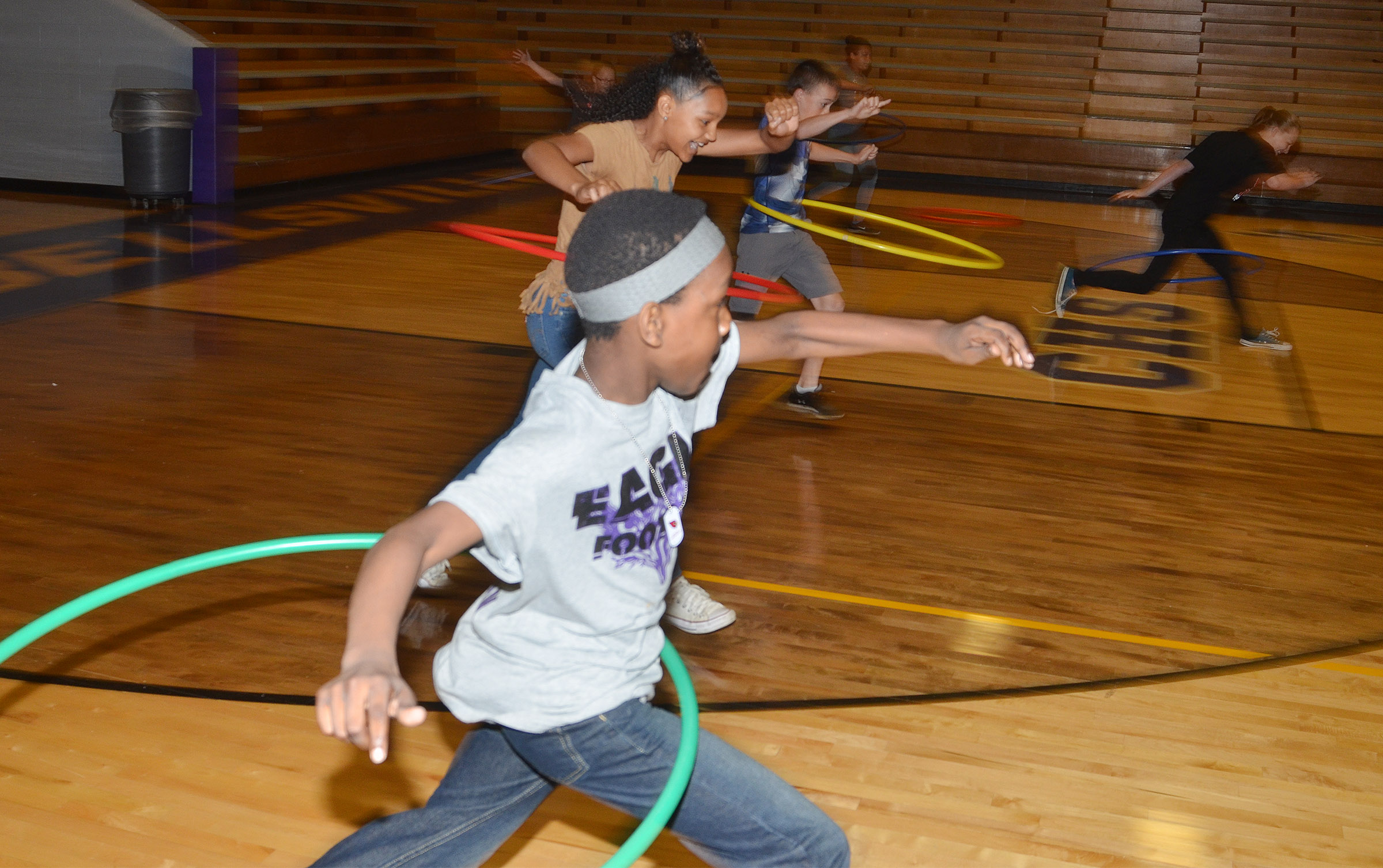 CMS seventh-grade Jadan Furman and his competitors run with their hula hoops.