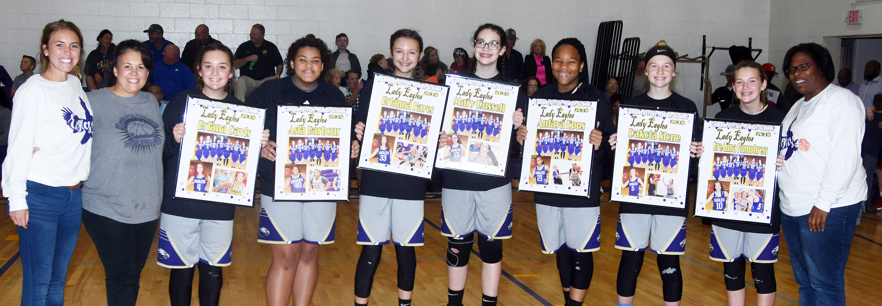 CMS girls' basketball eighth-grade players are honored. From left are assistant coaches LeeAnn Grider and Kathy England, Briana Davis, Asia Barbour, Brianna Hayes, Mary Russell, Antaya Epps, Dakota Slone, BreAnna Humphress and head coach Tiarra Cecil.