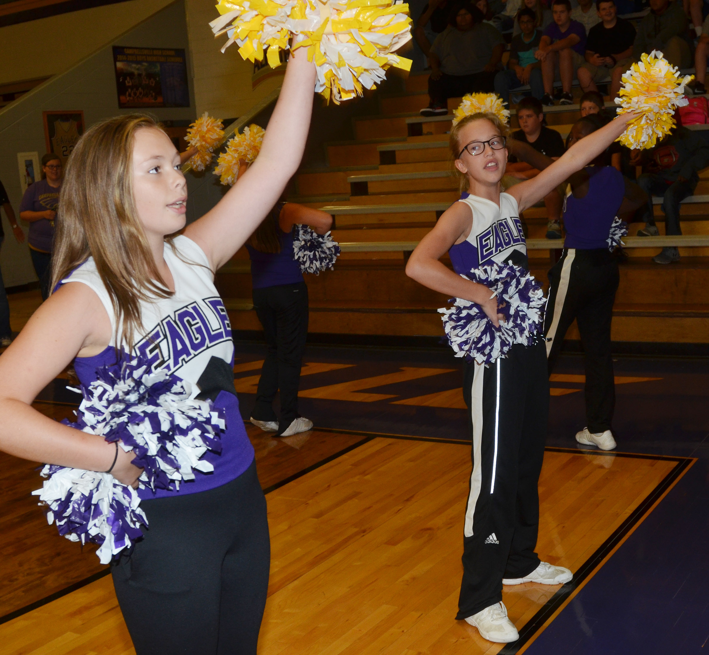 CMS sixth-graders CheyAnn Edwards, at left, and Chloe Thompson cheer for the Eagles.