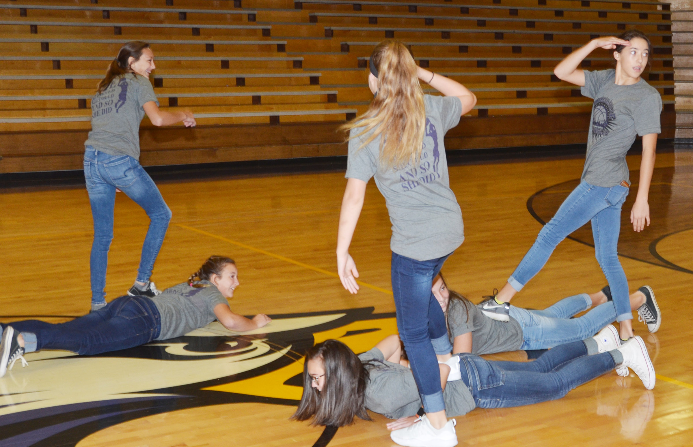 CMS girls' basketball players play the furniture game.