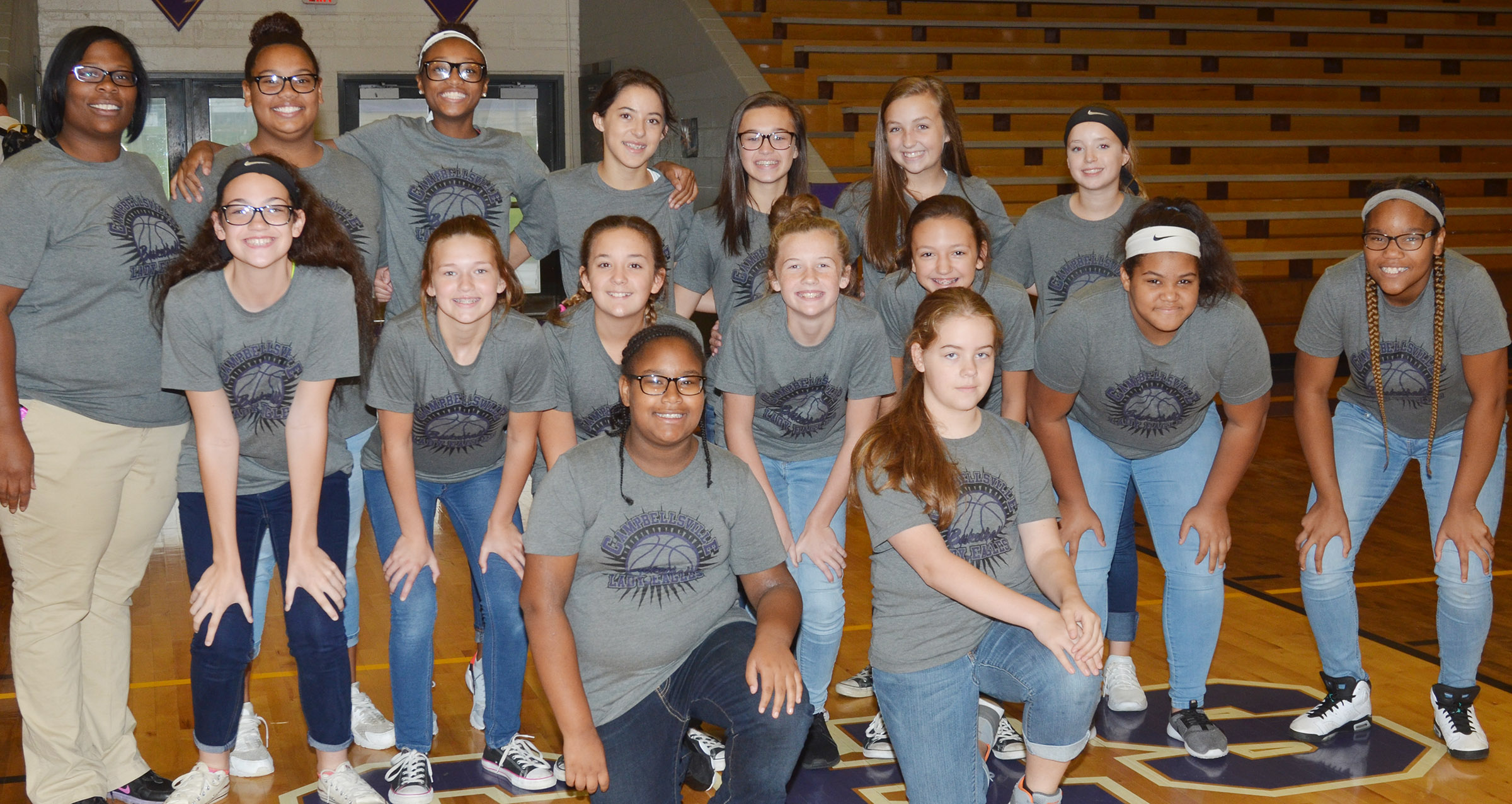 CMS girls' basketball players are honored at a pep rally. From left, front, are sixth-graders KyAshia Mitchell and Layla Steen. Second row, seventh-graders Mary Russell, BreAnna Humphress, Briana Davis, Dakota Slone, Bri Hayes, Asia Barbour and Antaya Epps. Back, head coach Tiarra Cecil and eighth-graders Brae Washington, Bri Gowdy, Kaylyn Smith, Tayler Thompson, Lainey Watson and Rylee Petett.