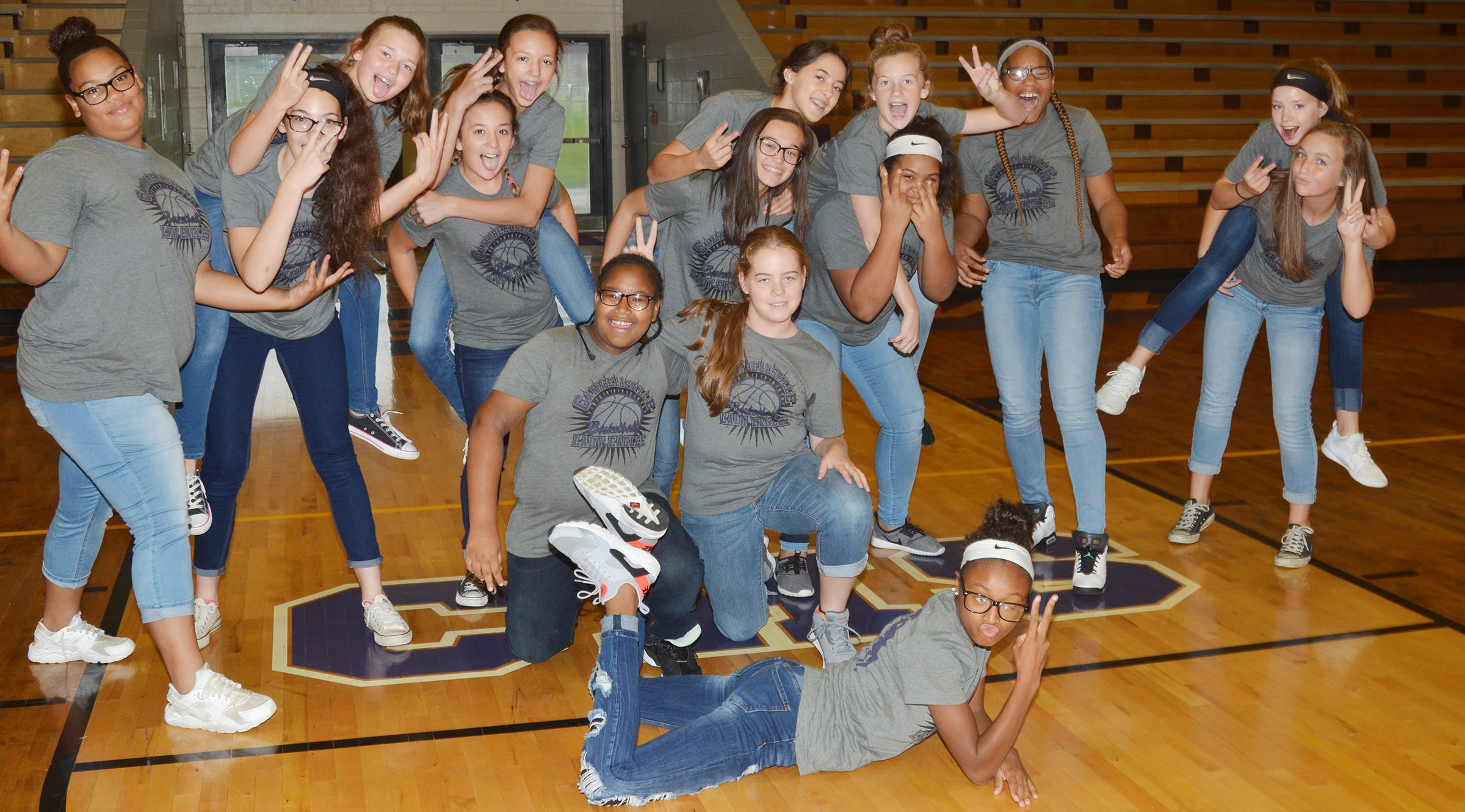 CMS girls' basketball players have fun together.