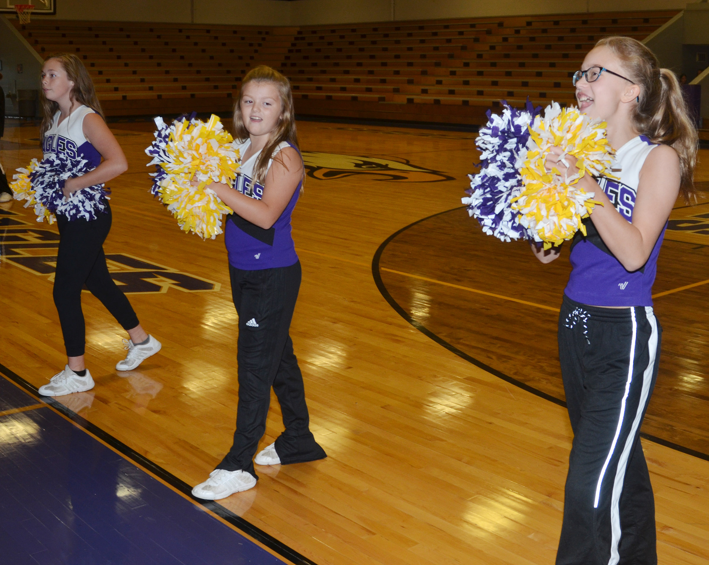 From left, CMS sixth-graders CheyAnn Edwards, Ellington Gowin and Chloe Thompson cheer for the Eagles.