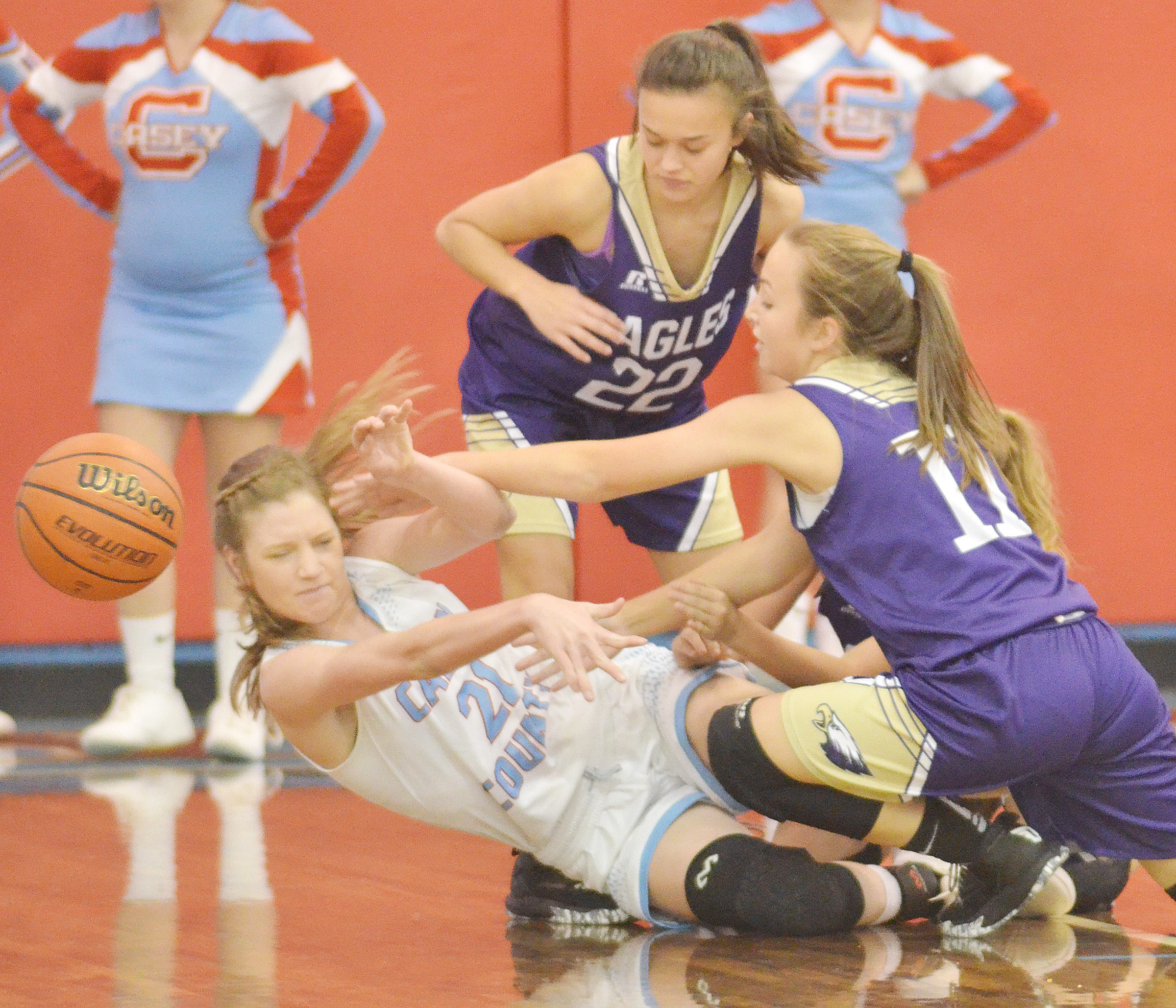 CMS eighth-graders Tayler Thompson, at left, and Lainey Watson battle for the ball.