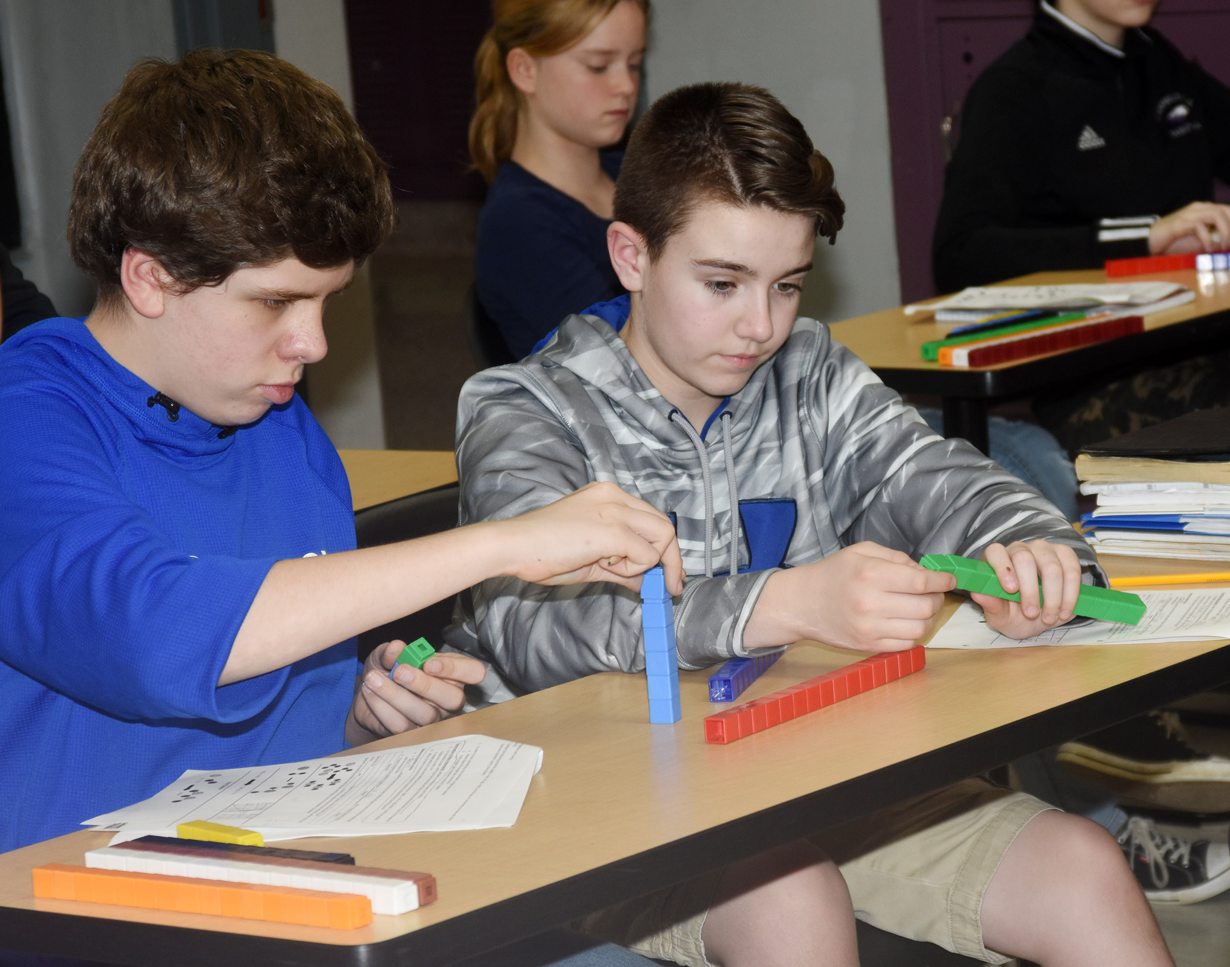 CMS seventh-graders Christopher Clark, at left, and Bryce Newton balance a chemical equation using blocks.